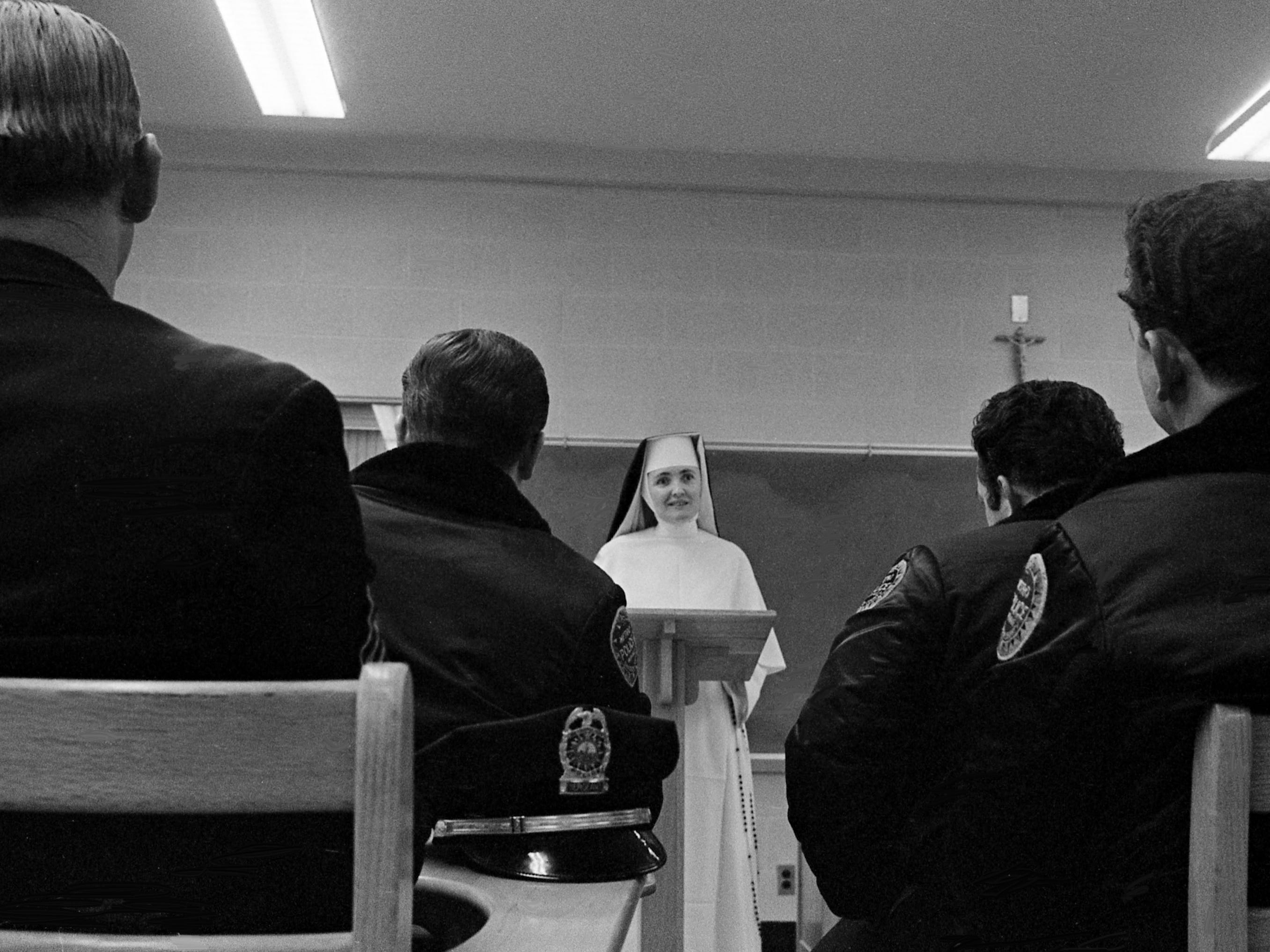 Sister Mary Bernard, center, an instructor at Aquinas Junior College, faces a classroom of Metro police officers taking part in a unique program Jan. 28, 1969. The college now offers an Associate of Arts degree to police officers completing the requirements, including at least 20 semester hours of police science courses.