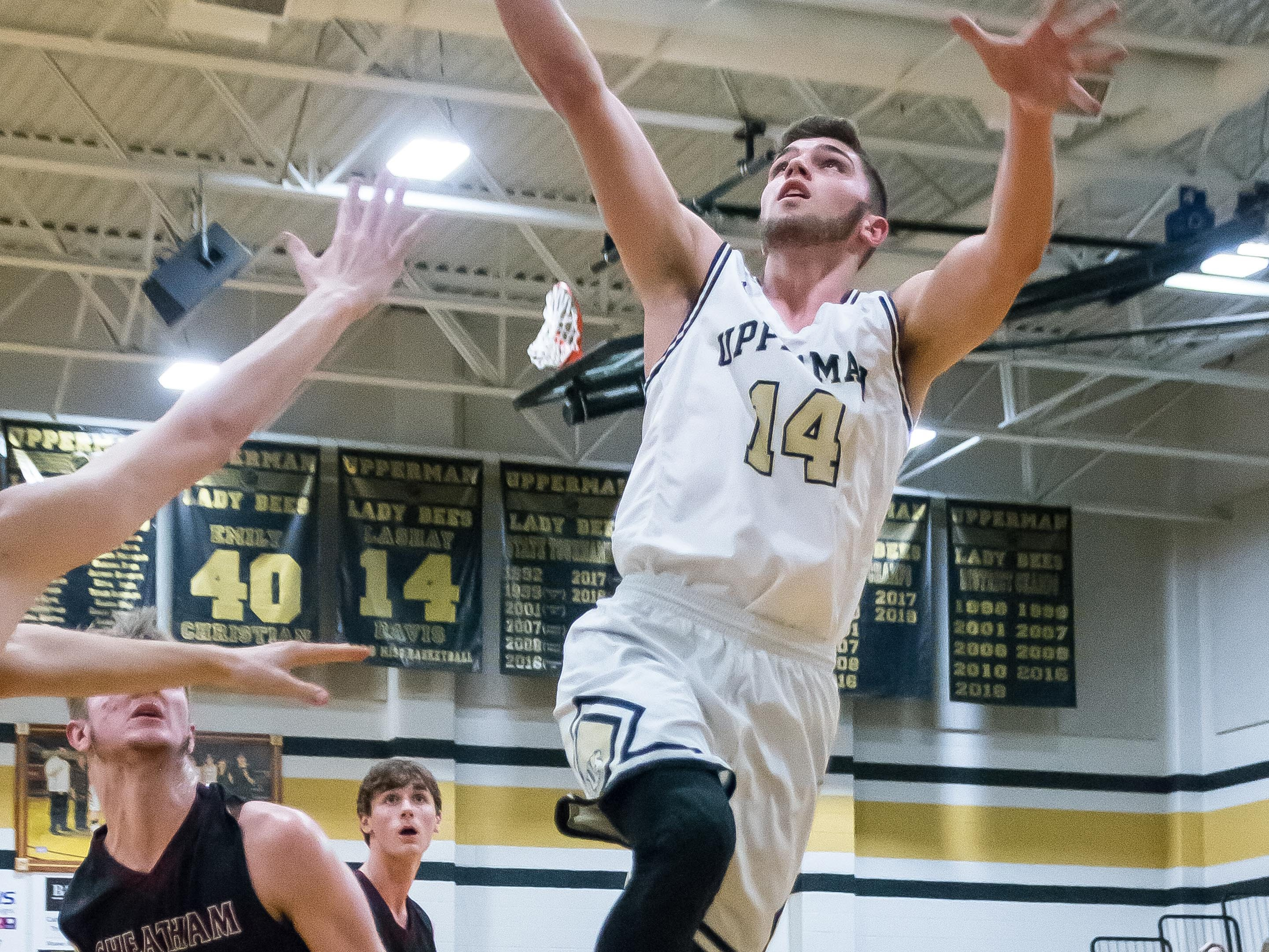 Upperman's Jaydon Knipe goes to the basket for another two points.