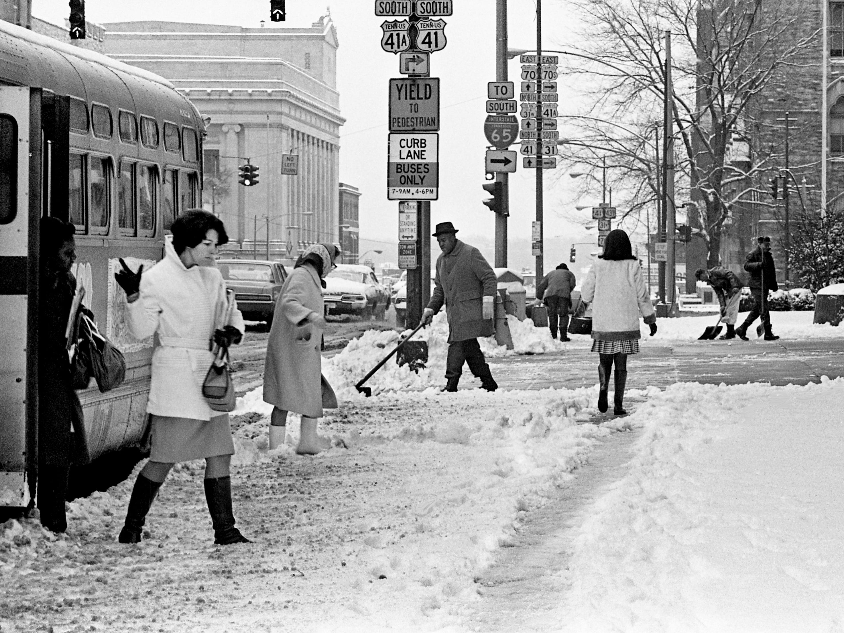 Four inches of snow cause treacherous footing for folks reporting to work on Broadway in downtown Nashville on Jan. 27, 1969.