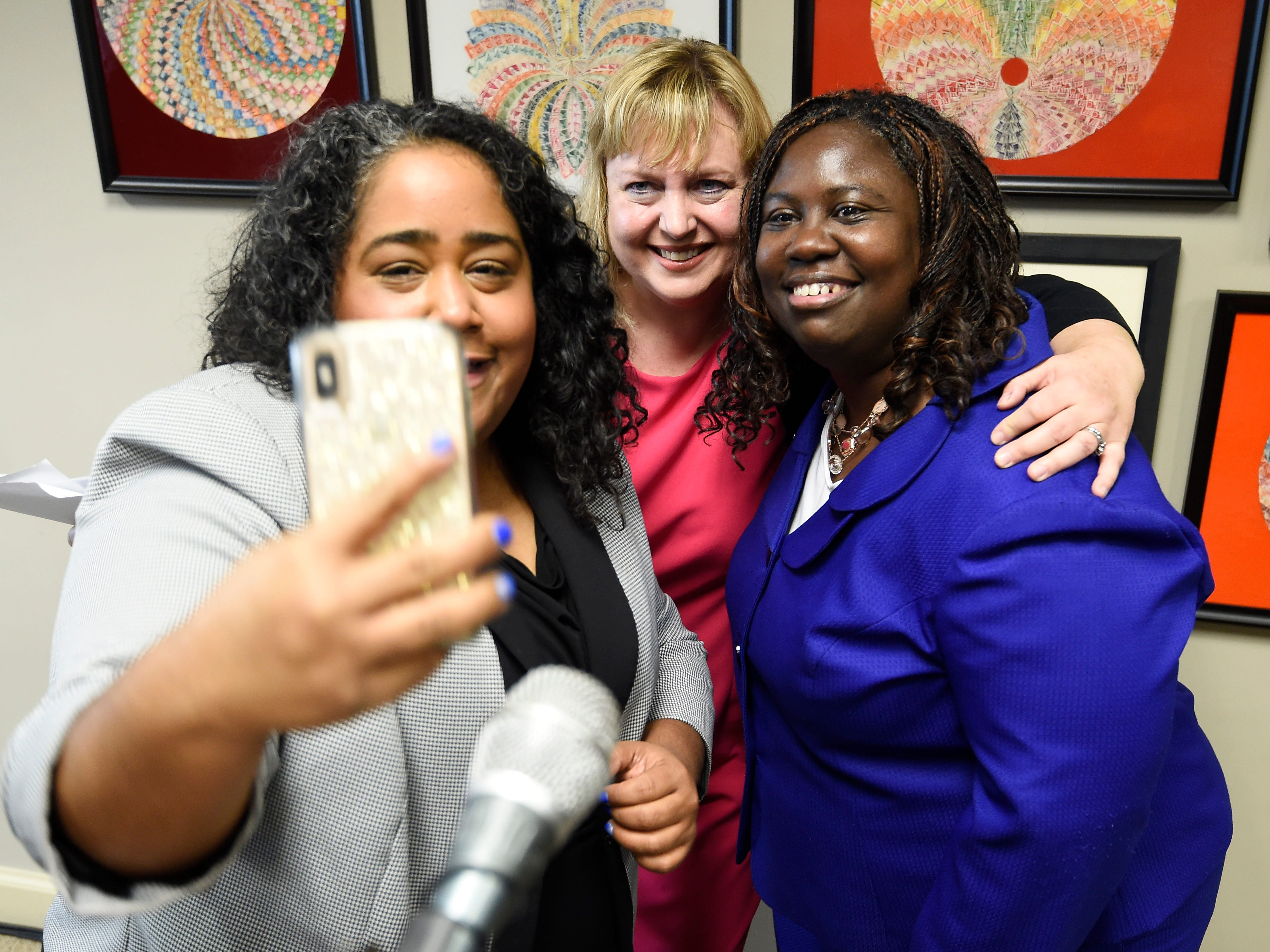 State Sen. Raumesh Akbari takes a selfie with Juvenile Court Administrator Kathy Sinback and Juvenile Court Judge Sheila Calloway at a press conference Monday, Jan. 7, 2019, in Nashville, Tenn., after Gov. Bill Haslam granted full clemency to Cyntoia Brown, and set an Aug. 7 release date for her from prison.