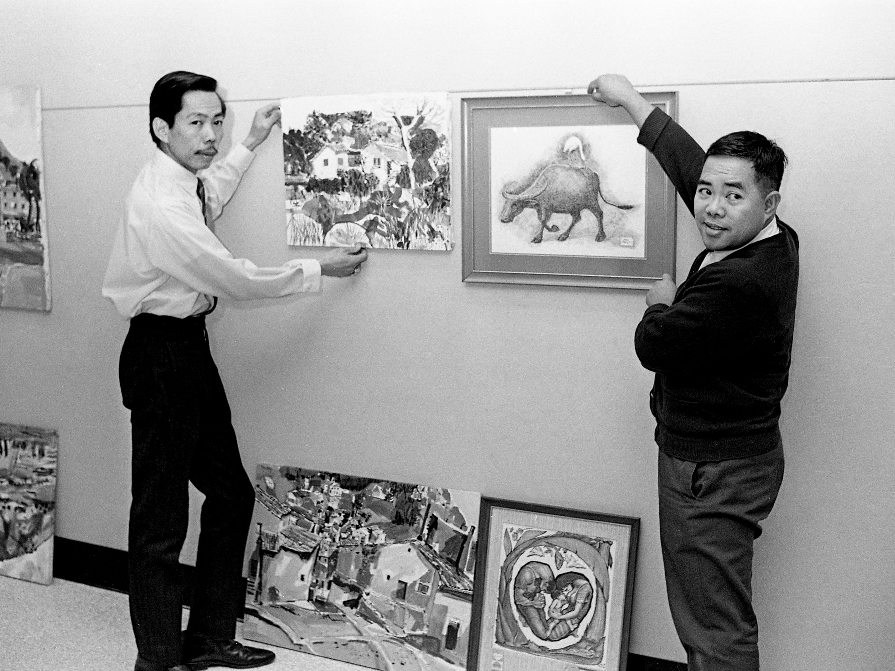 Lito David, left, and Dani Aguila, natives of the Philippines, set up their two-man show of paintings and drawings Jan. 2, 1969, at the Parthenon in Centennial Park. Philippine Ambassador Salvador P. Lopez was set to attend the opening reception.