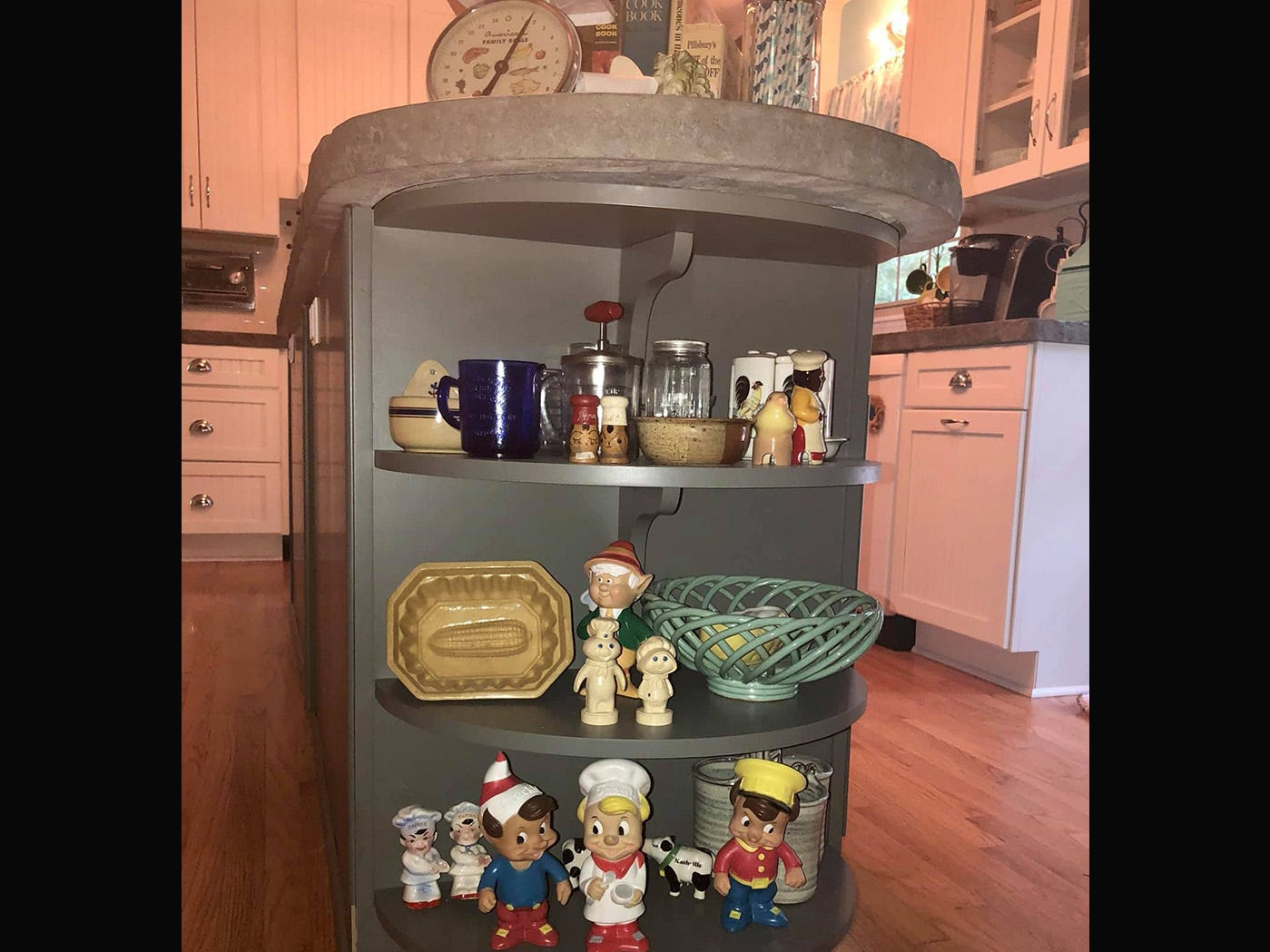 Pop culture knick knacks, collected from antique stores, add a pop of color to the retro kitchen design.