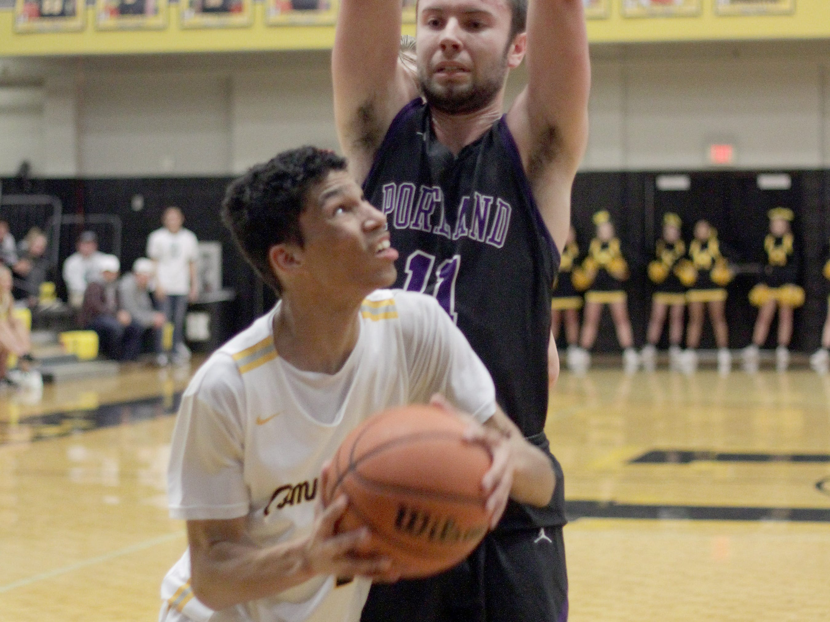 Hendersonville's Andruw Stratton looks to shoot as Portland's Austin Hicks looms from above on Friday, January 4, 2019. Hendersonville won 62-39.