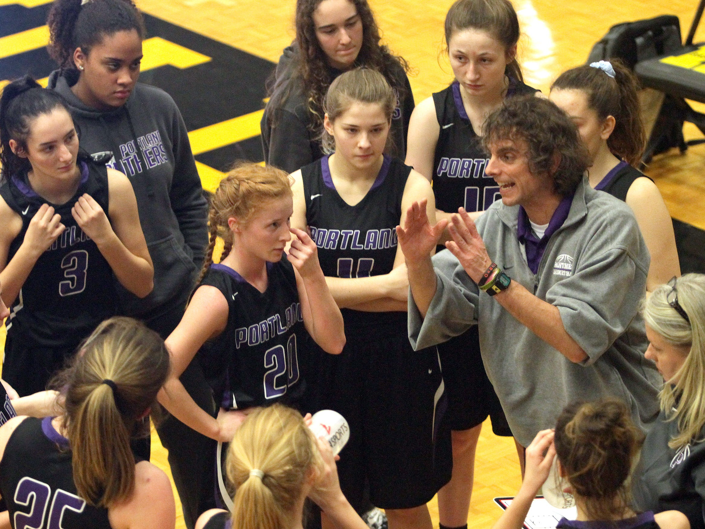 Portland coach Scott Steinbrcher talks with his team as they play Hendersonville on Friday, January 4, 2019.