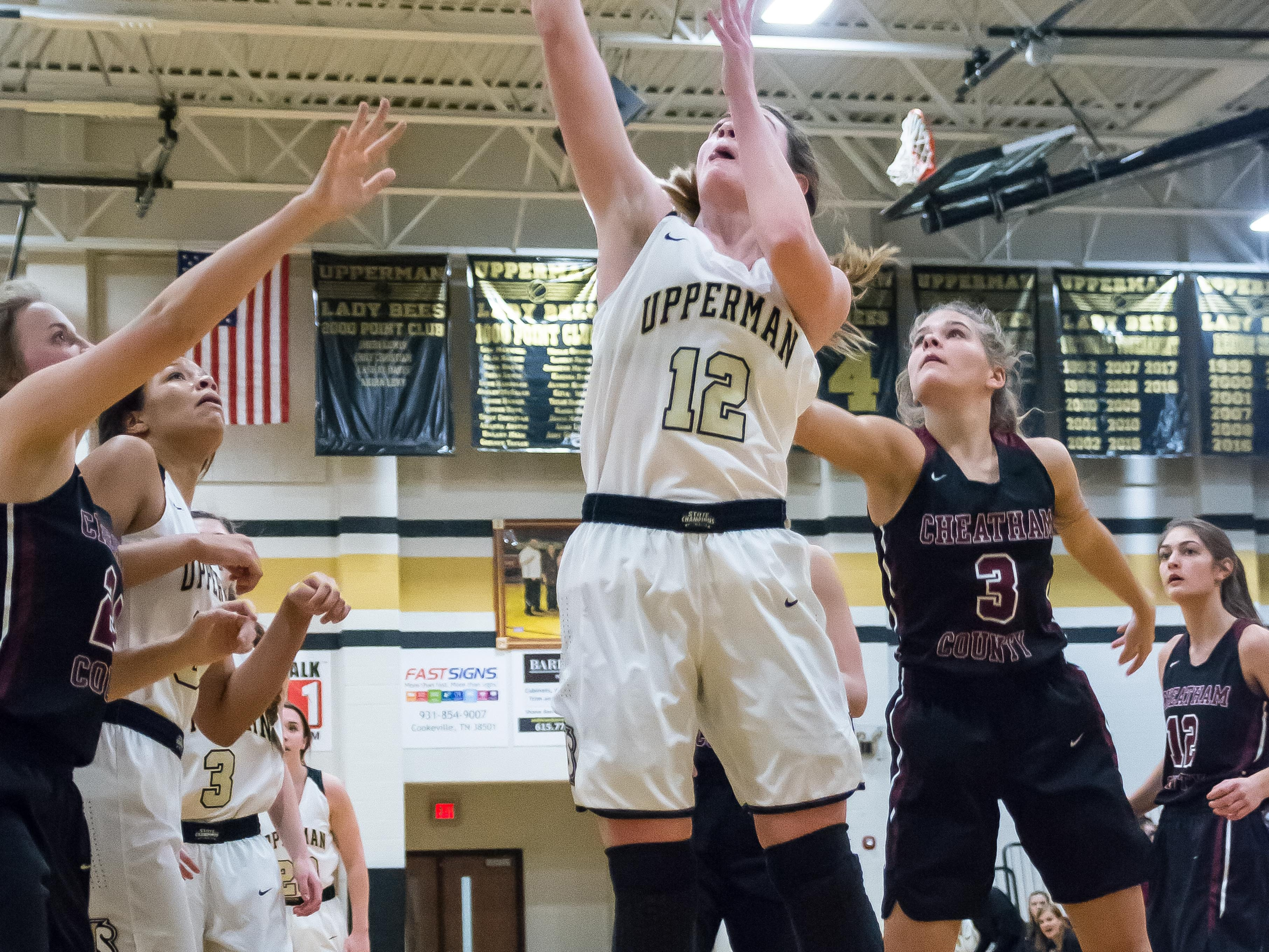 Upperman ladies' Brooke Shrum putting up a shot.
