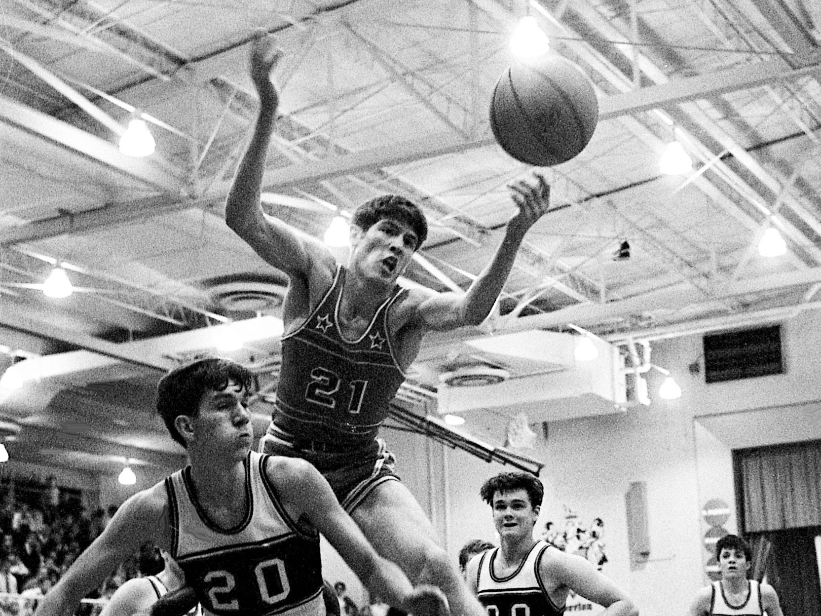 Glencliff High's David Lane (21) attempts to go over Overton High's Johnny Murphy (20) for the rebound during their 19th District battle, which went into overtime Jan. 10, 1969, before Glencliff finally pulled out a 55-53 win.