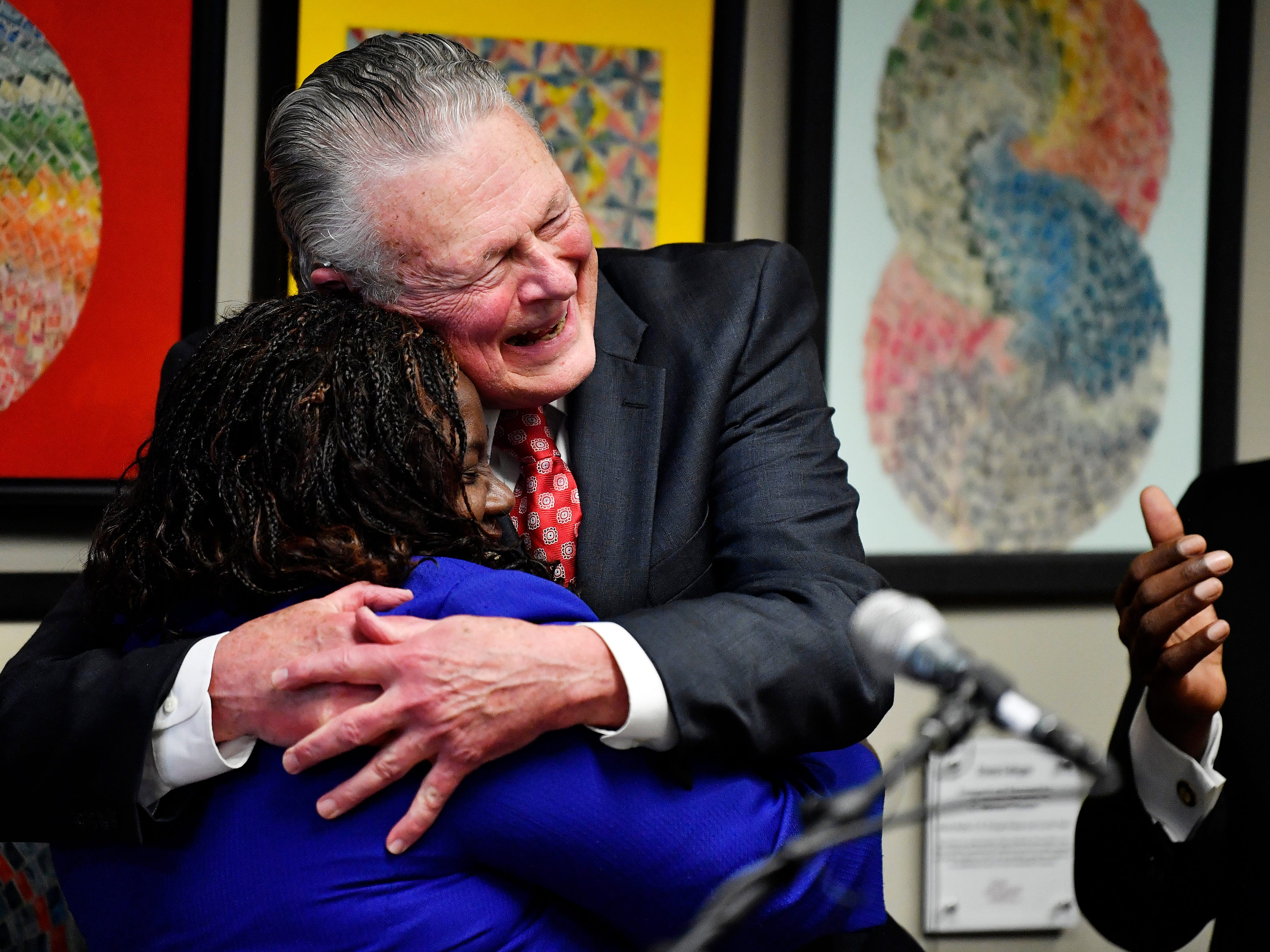 Attorney Charles Bone hugs Juvenile Court Judge Sheila Calloway at a press conference Monday, Jan. 7, 2019, in Nashville, Tenn., after Gov. Bill Haslam granted full clemency to Cyntoia Brown, and set an Aug. 7 release date for her from prison.