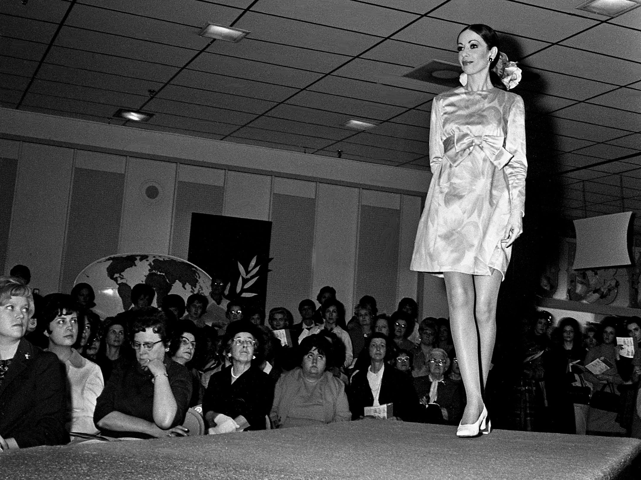 Frederique Biffi, an Italian beauty from Nice, models a Chester Weinberg design during Cain-Sloan's annual Boussac-Vogue Pattern fashion show on the third floor of the downtown store Jan. 30, 1969.