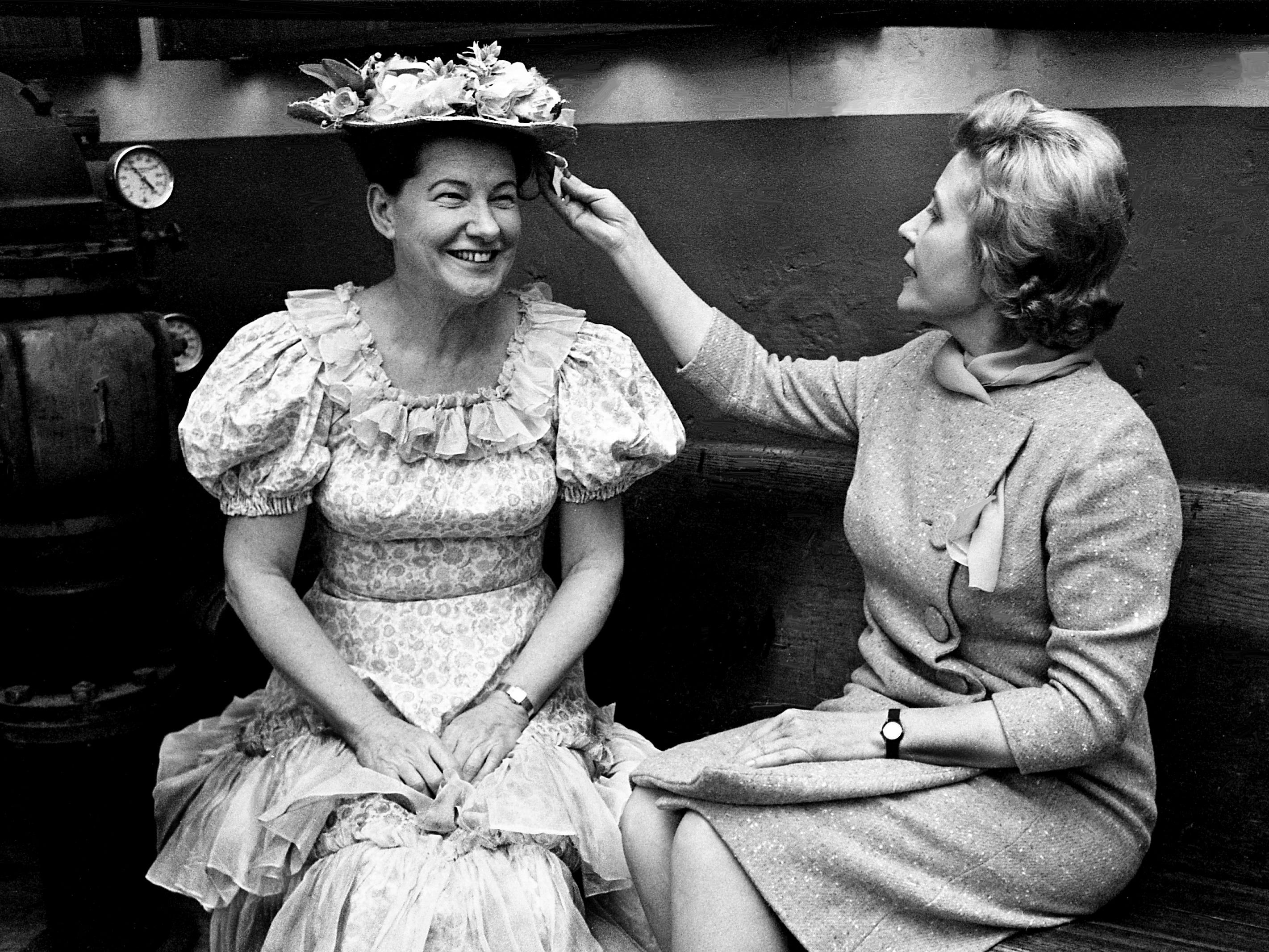 Soprano Signe Quale Dawson, right, of Tennessee's unique traveling opera company, checks out the price tag on the hat of Grand Ole Opry leading lady Minnie Pearl during a visit to the Ryman Auditorium on Jan. 29, 1969.