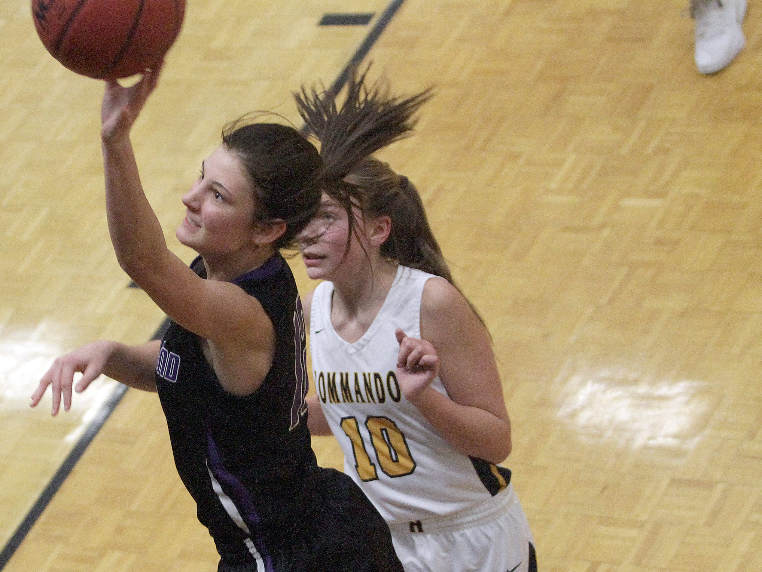 Portland Abi Thomerson drives past Hendersonville's Brette Taylor on Friday, January 4, 2019.