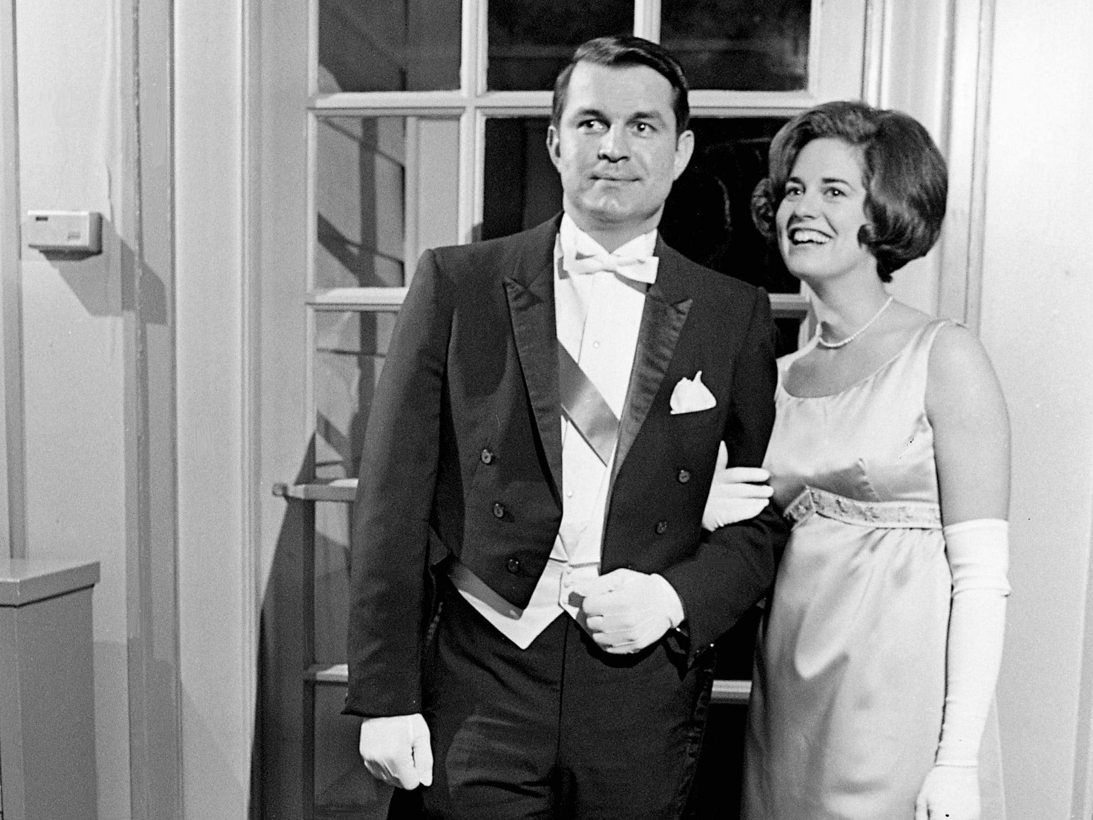 The Bachelor Club of Nashville President Alan Goar, left, and Julie Palmer of Boston arrive for the club's winter formal dinner and dance at the Belle Meade Country Club on Jan. 18, 1969.