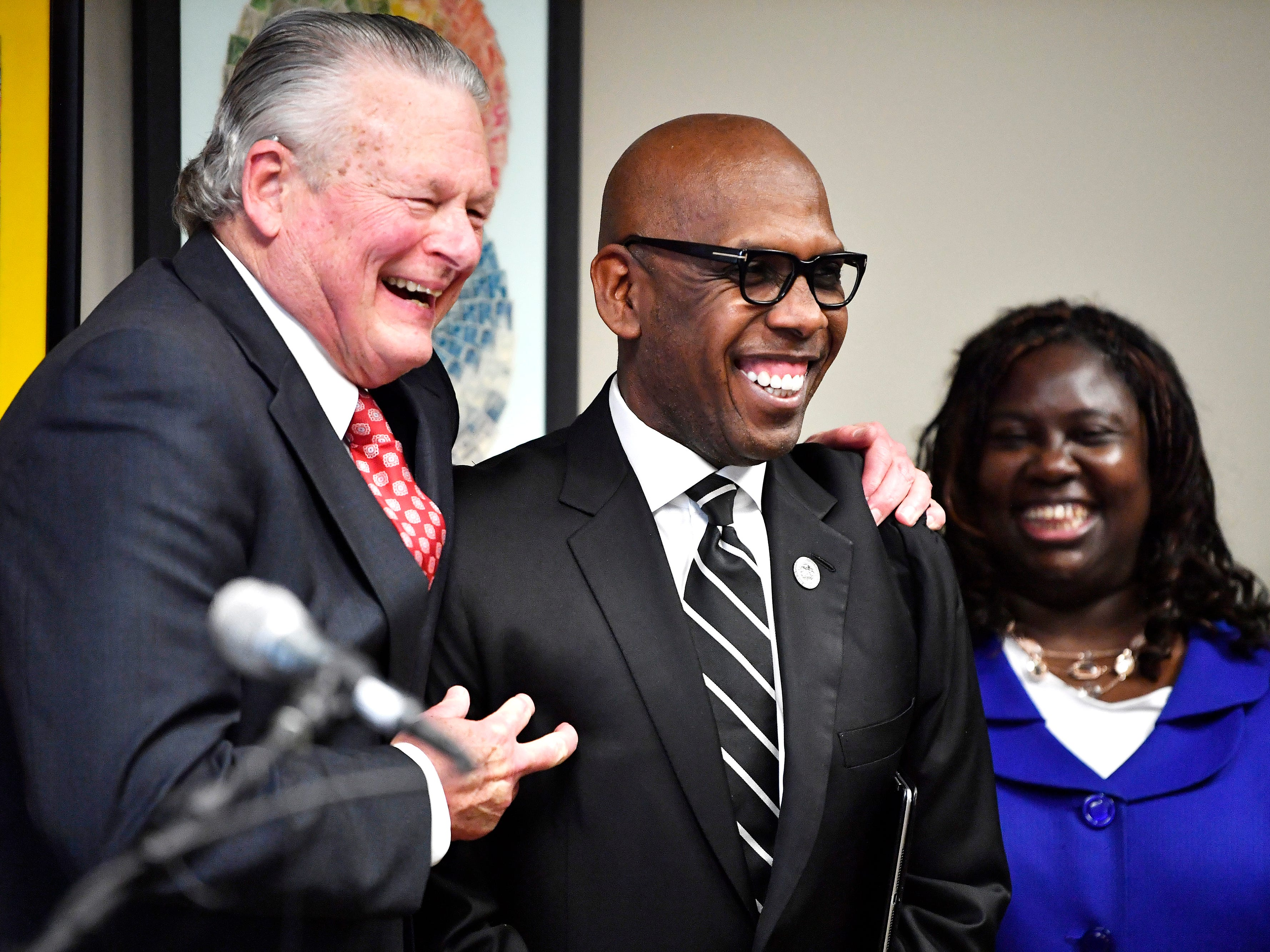 Attorney Charles Bone celebrates Gov. Bill Haslam's clemency ruling with Bishop Joseph Walker as Juvenile Court Judge Sheila Calloway looks on at a press conference Monday, Jan. 7, 2019, in Nashville, Tenn., after Haslam granted full clemency to Cyntoia Brown, and set an Aug. 7 release date for her from prison.