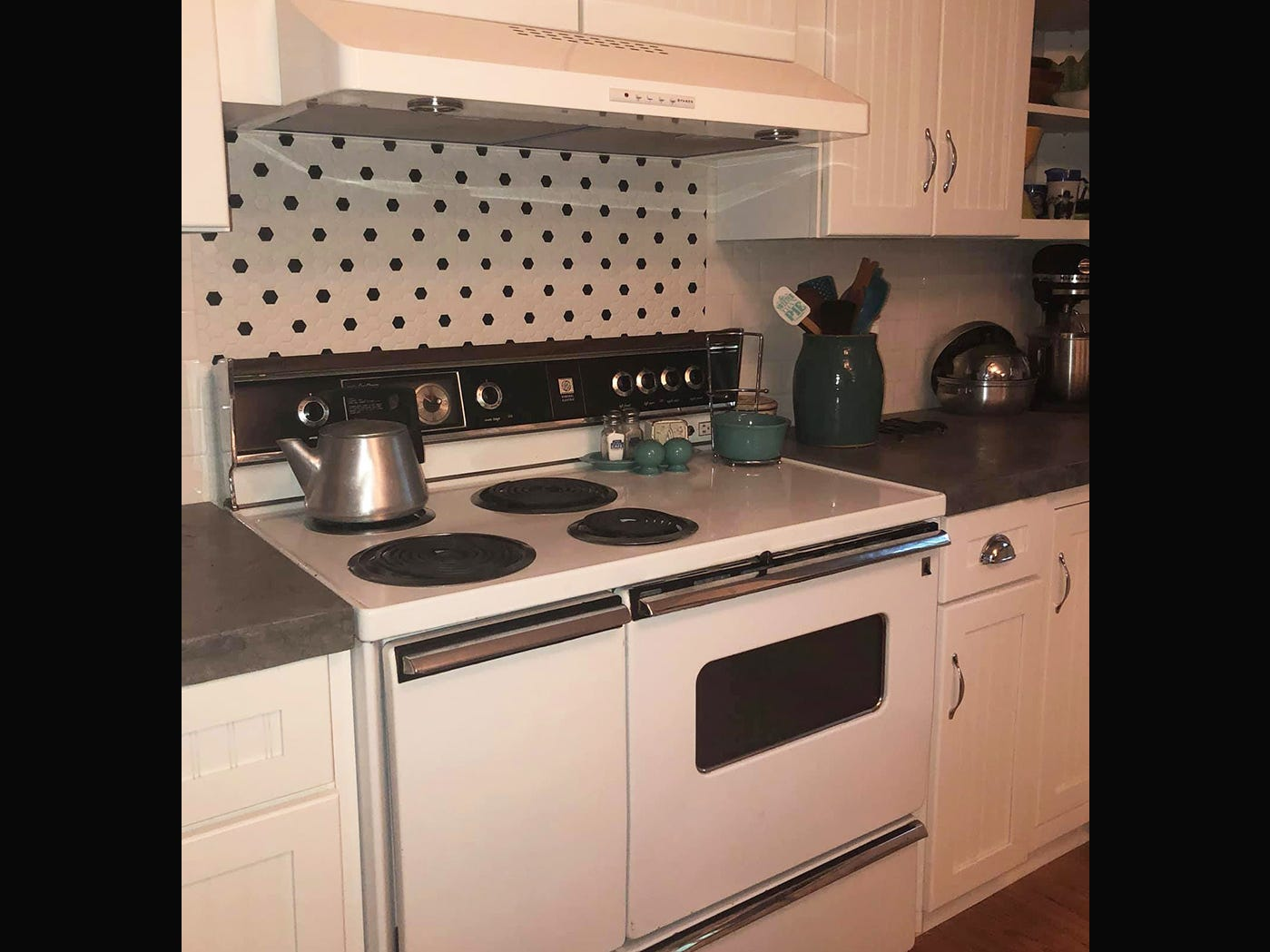 The 1956 General Electric stove found a temporary home in Kathleen Walter's retro kitchen. She plans to replace it with a restored 1955 General Electric stove with double ovens in the near future.