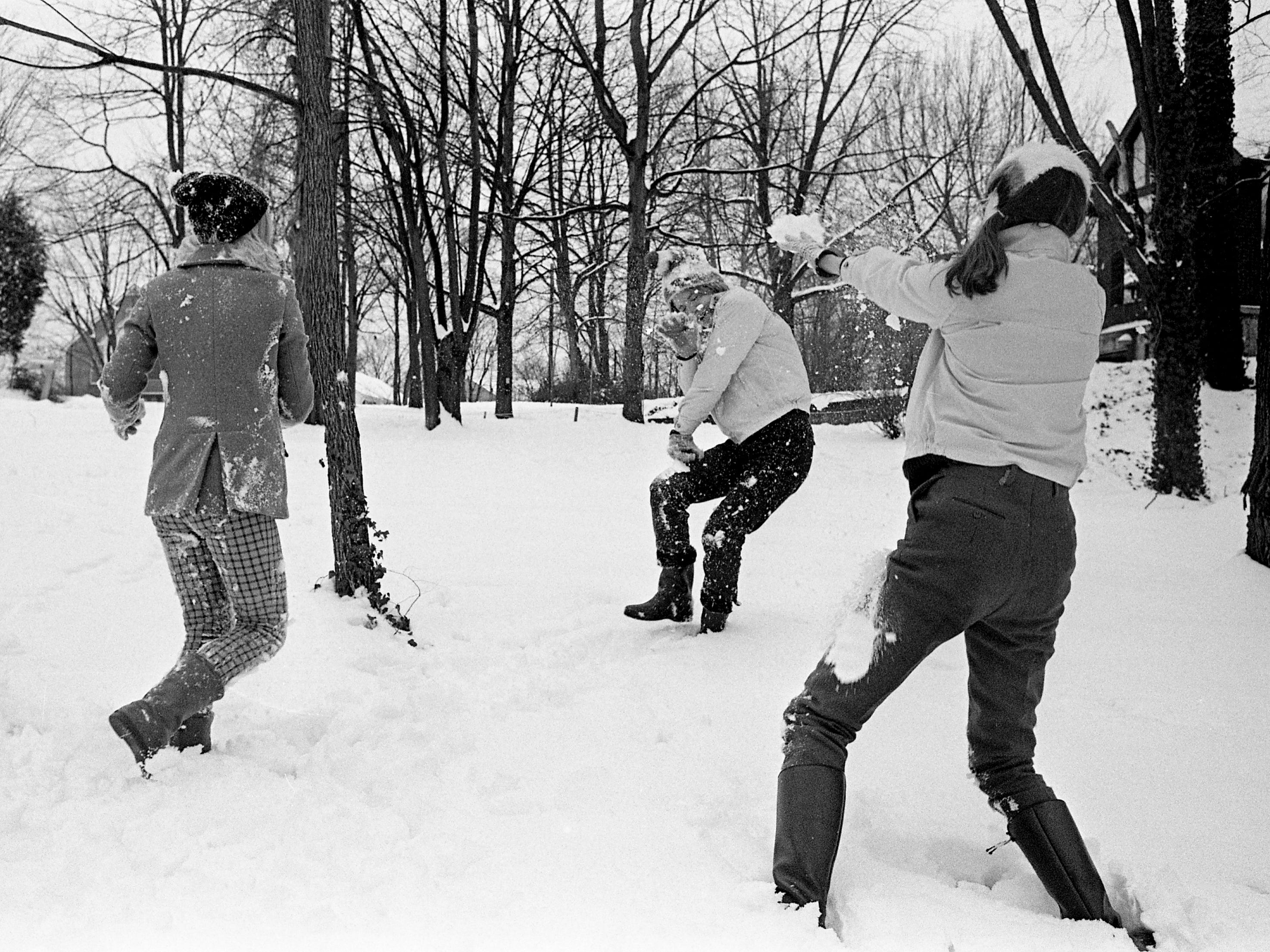 Three Hillsboro High School students, getting the school day off, find Nashville's first snow of winter ideal for a snowball battle Jan. 27, 1969. Mary, left, and Marty Hanserd of Hillmont Drive and Susan Snell of Granny White Pike let the snowballs fly.