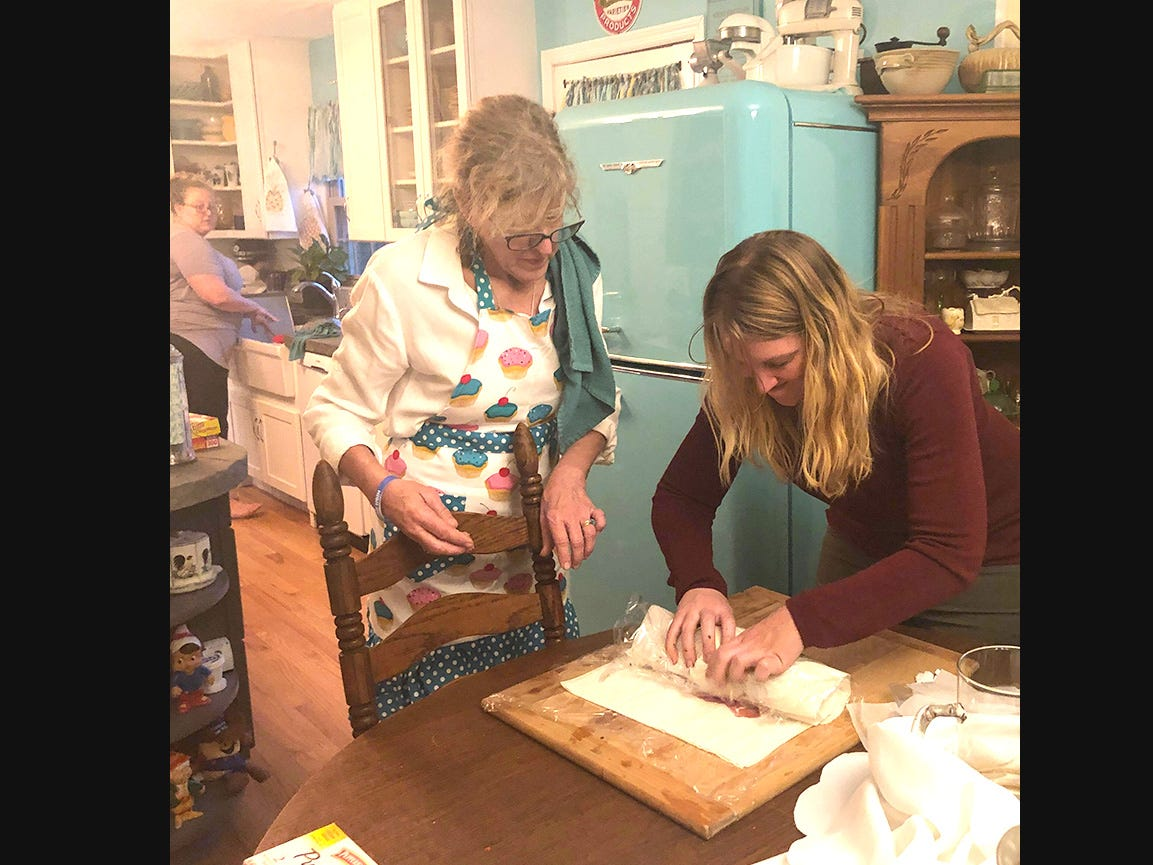 Kathleen Walter and her daughters enjoy preparing their holiday dinner in the kitchen.