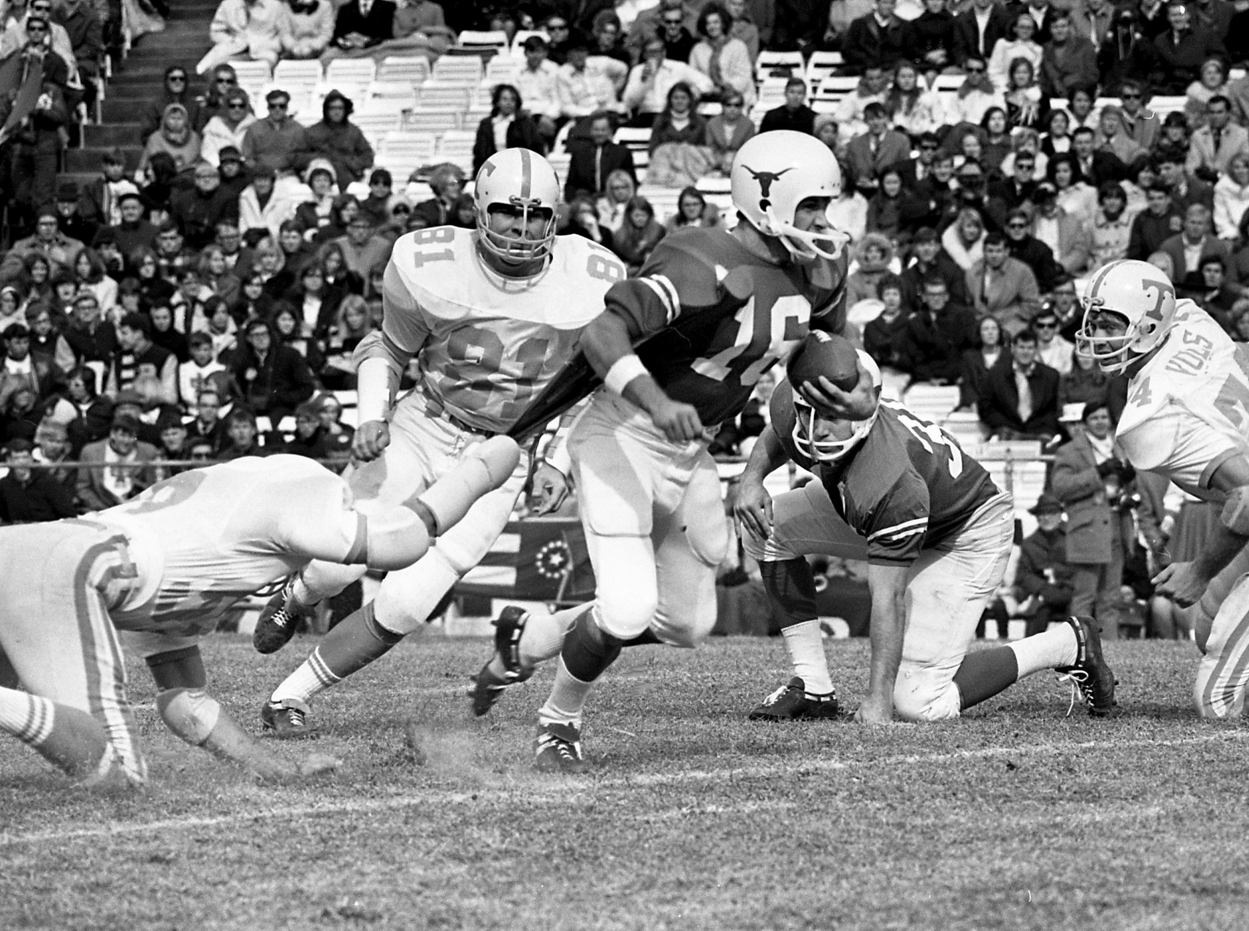 A Tennessee defender grabs the jersey of Texas quarterback Jim Street (16) during the Cotton Bowl on Jan. 1, 1969, in Dallas. Texas gored Tennessee 36-13 before 72,000 in the 33rd annual New Year's Day classic.