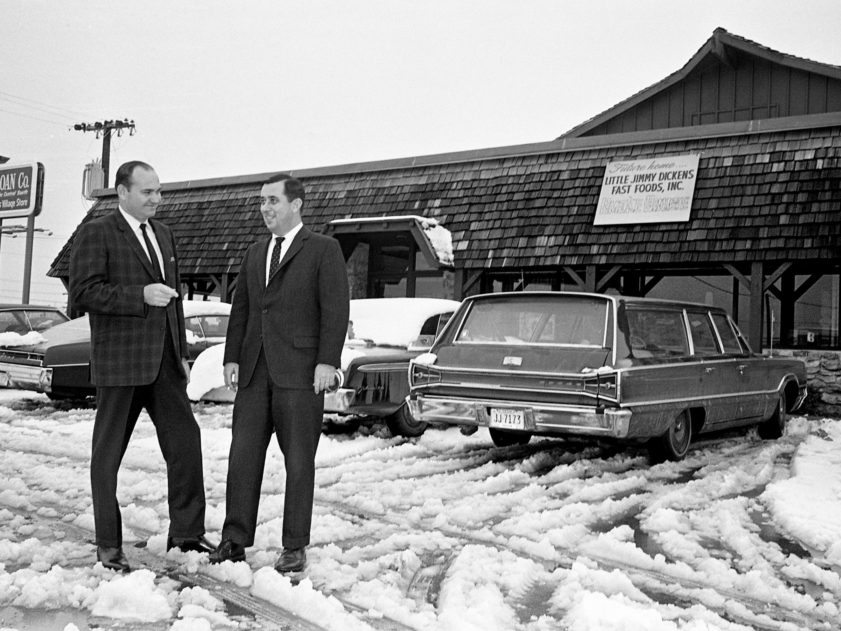 "Despite the snow blanketing Nashville on Jan. 27, 1969, Paul Shockley, left, executive vice president, and W.G. ""Bill"" Webber, president, check on their Little Jimmy Dickens Fast Foods Inc.'s just-opened pilot store, Little Jimmy Dickens Smokehouse at 2030 Richard Jones Road."