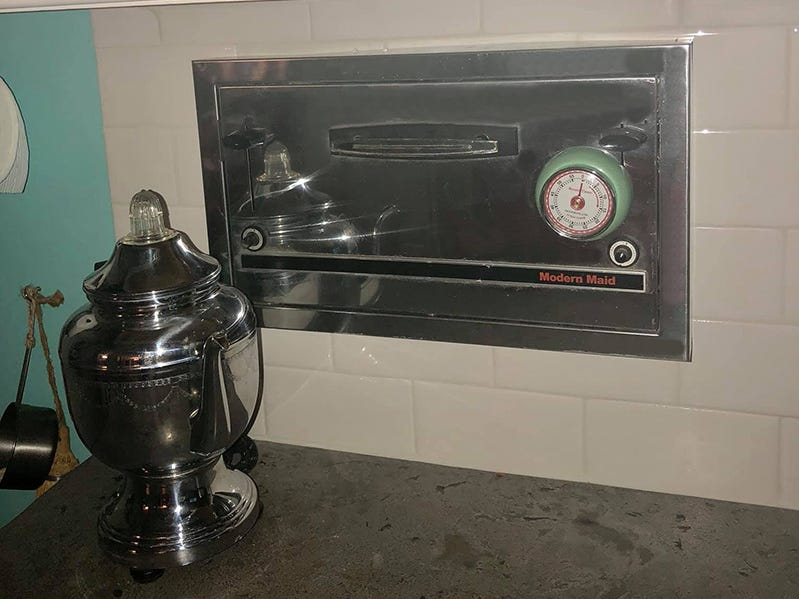 Katheen Walter added some unique and antique features to her retro 1950s kitchen including this 1960 Modern Maid in-wall, four-slice toaster.