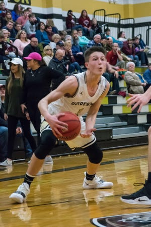 Collin Gore gets ready to make a move for Upperman.