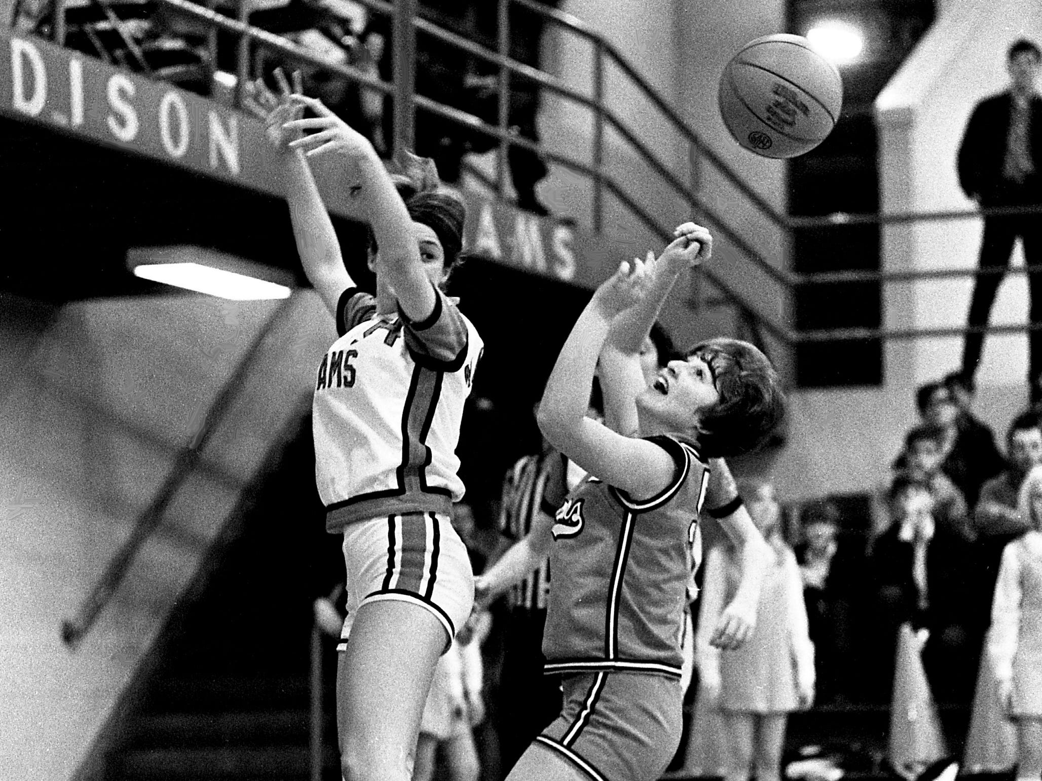 Madison High's Sheila Grant, left, and Stratford High guard Kathy Hiland watch the rebound get away from them. The Stratford girls seem to be in full control of the NIL and 19th District races after defeating Madison 55-40 on the road for their 11th straight league victory and 13th of the year.