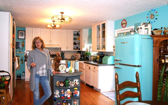 Fairview's Kathleen Walter stands in her newly-renovated retro 1950s kitchen.