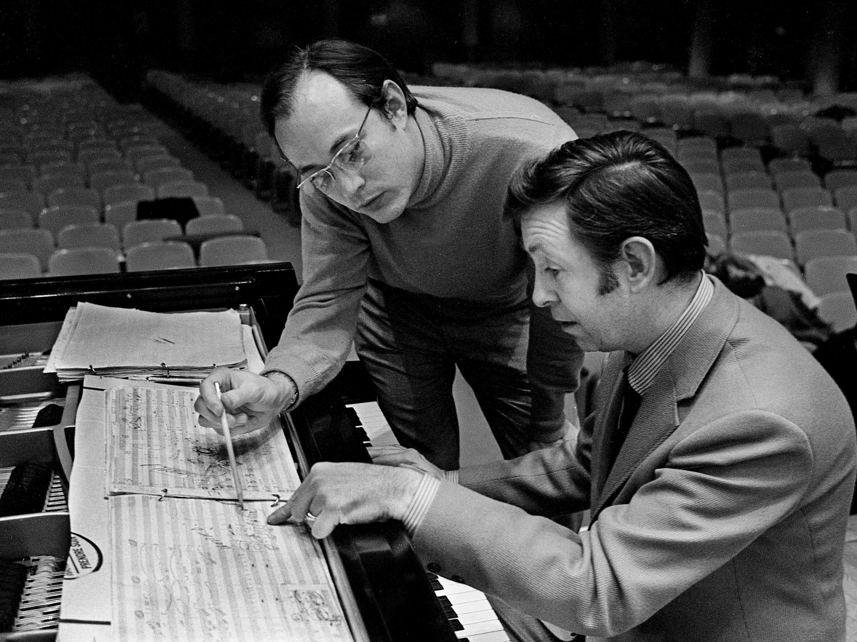 "Composer Tupper Saussy, top, works with pianist Bill Pursell during rehearsal Jan. 6, 1969, on his first original piano concerto, ""Hausgeists"" (""House Ghosts""), to be performed at War Memorial Auditorium. The 95-page score evokes the ""spirits"" of three historic houses in the Nashville area."