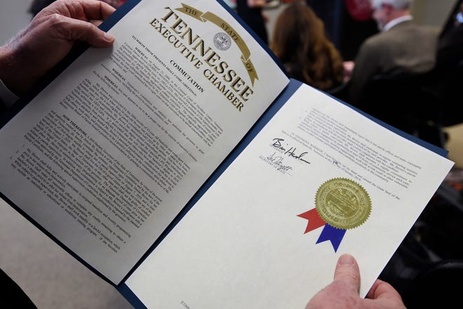 The executive clemency order from Gov. Bill Haslam at a press conference Monday, Jan. 7, 2019, in Nashville, Tenn., after Haslam granted full clemency to Cyntoia Brown, and set an Aug. 7 release from prison.