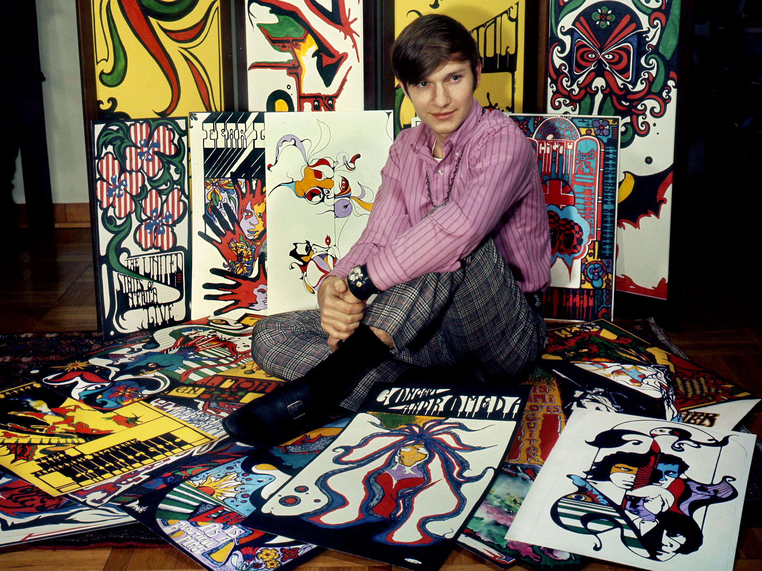 "Tim Buckley, The Doors and other ""new sound"" groups inspired the posters that surround Sonny Bodo on Jan. 16, 1969. The Montgomery Bell Academy sophomore will have a show of his work at his school. Behind him is a paneled screen he was commissioned to paint for Dr. Lee Mintor."