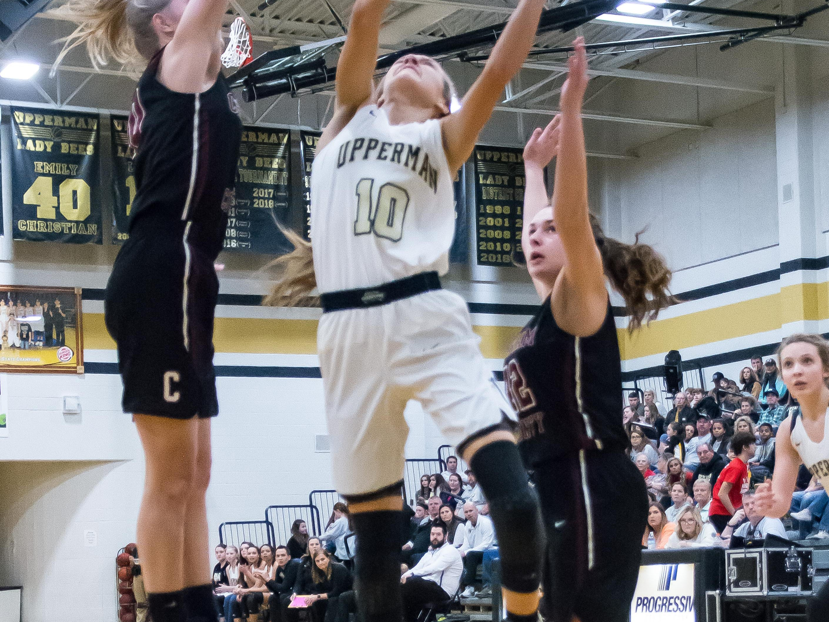 Another look at Reagan Hurst putting up a shot for Upperman.