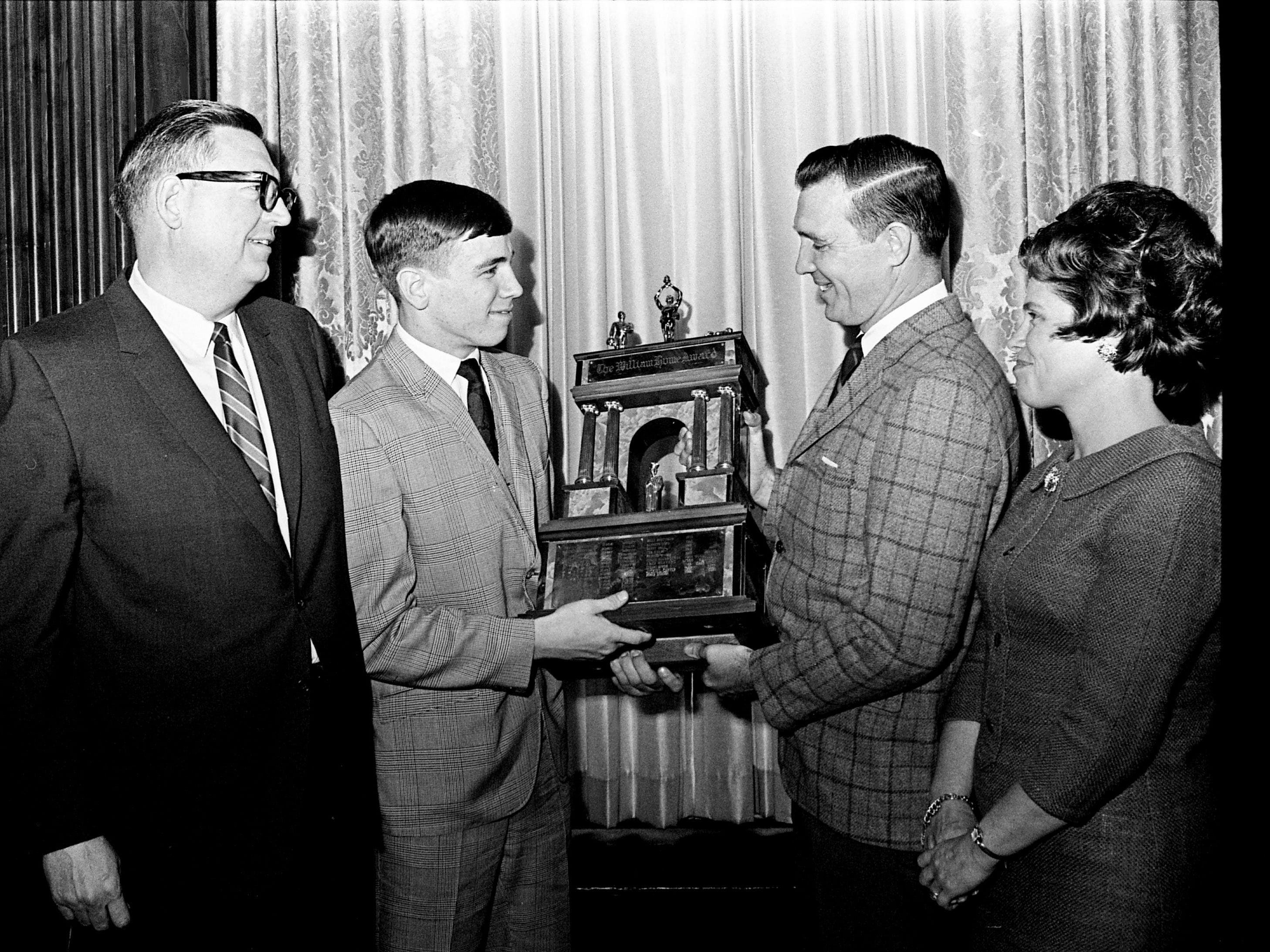 Butch Stinson, second from left, of Cohn High School holds the William Hume Award he received with his parents, Mr. and Mrs. Homer Stinson, right, during the Exchange Club meeting at the Hermitage Hotel on Jan. 21, 1969. The award, the 25th annual one, is based on sportsmanship, scholarship and individual performance on the football field and value to the team.