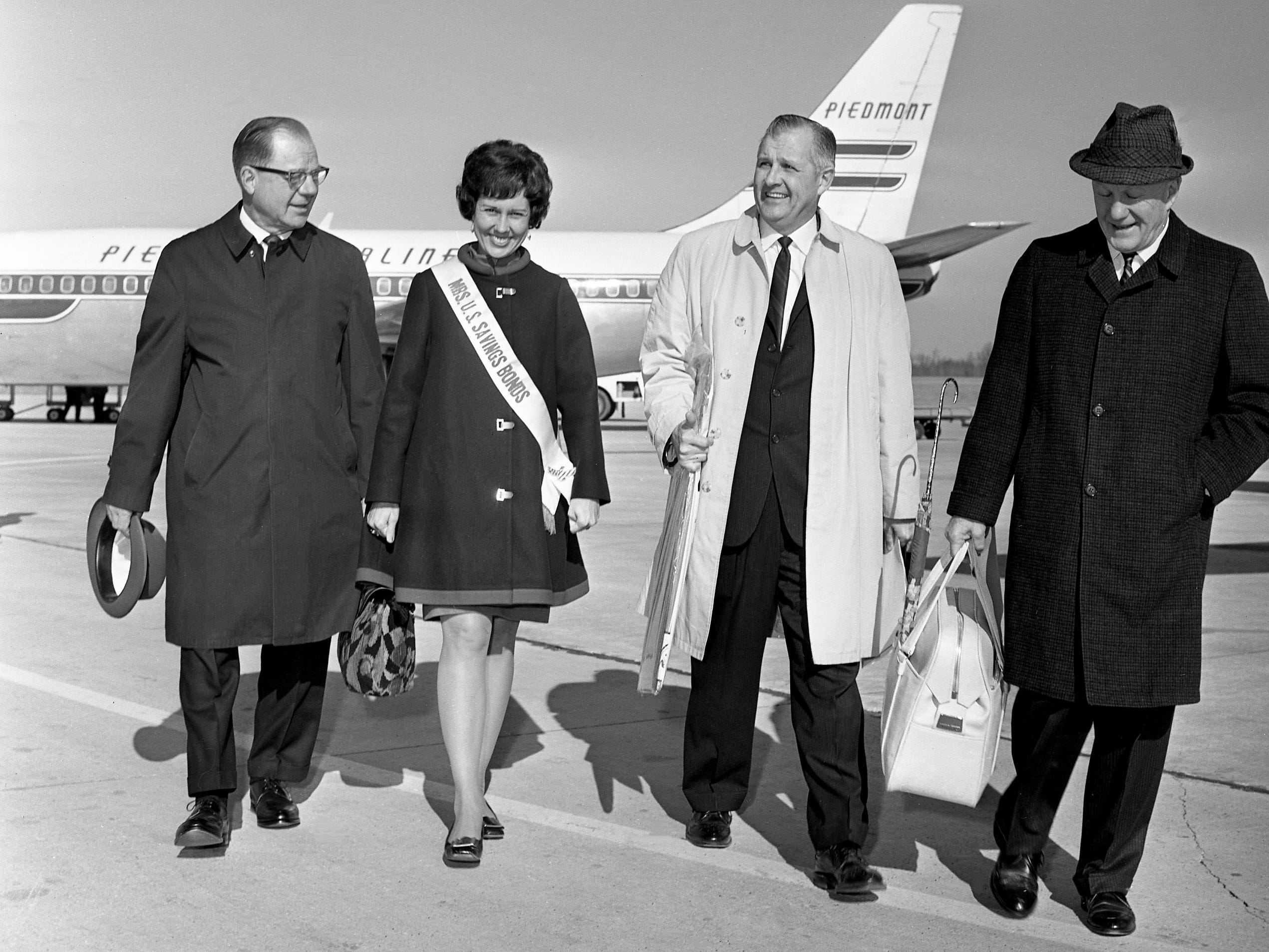 Joy Berlemann, second from left, Miss U.S. Savings Bonds of 1969, is surrounded by local savings bonds officials after arriving at Nashville Municipal Airport on Jan. 10, 1969, to help boost Nashville's bond campaign. With her are Postmaster Lewis Moore, left, J.P. Lawrence and Norvell S. Rose.