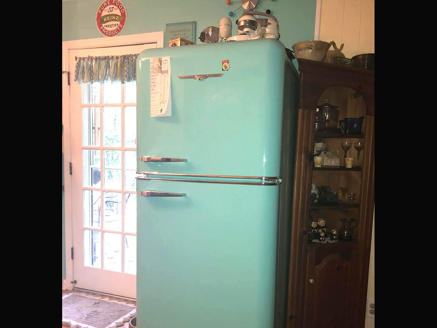 The new 1952 model Robin's Egg Blue refrigerator was an essential component of the retro kitchen.