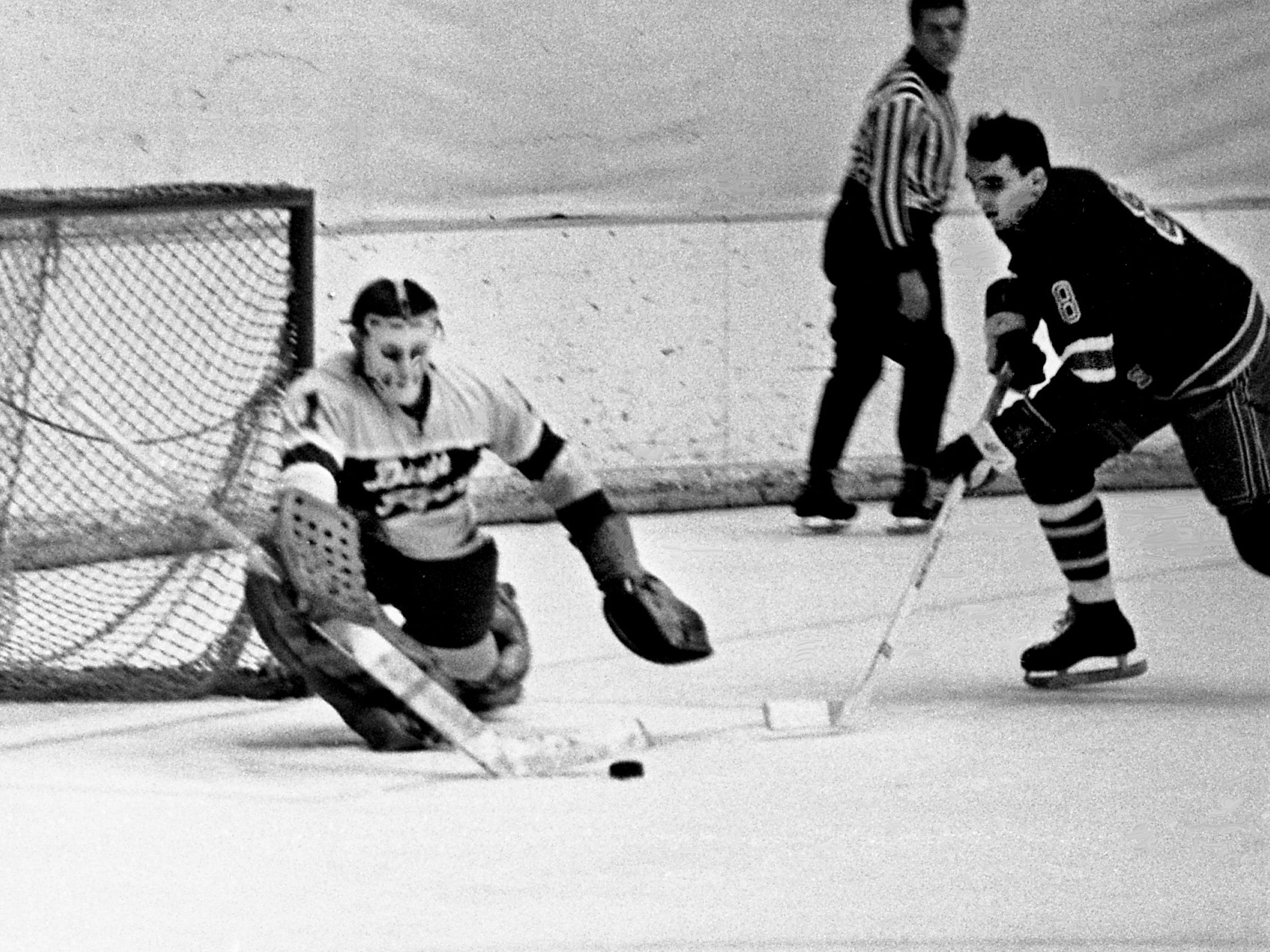 Nashville Dixie Flyers goalie Duffy Lewis clears the puck as a Salem Rebels player moves in. The Flyers defeated Salem 4-2 before 2,847 fans at Municipal Auditorium on Jan. 11, 1969.