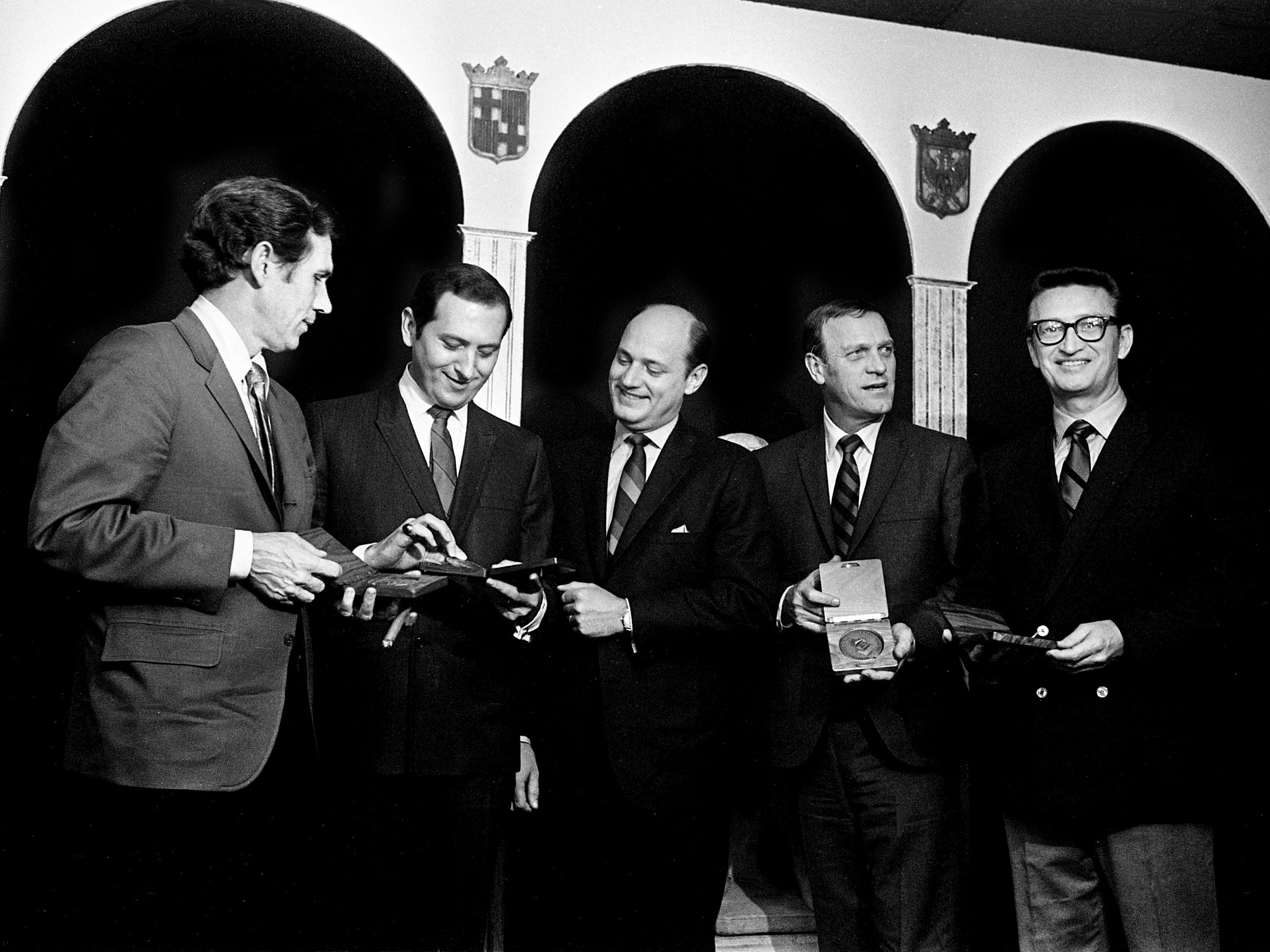 The four past presidents of the Nashville chapter of NARAS (National Academy of Recording Arts and Sciences) check out commemorative medallions that have just been presented to them Jan. 30, 1969, by guitarist Chet Atkins, left, a leader in the Nashville Sound. They are Buddy Killen, second from left, Bill Denny, Eddy Arnold and Harold Bradley.