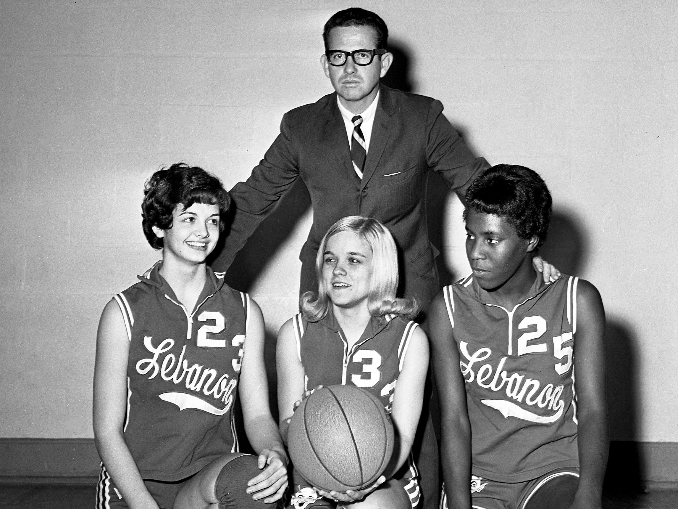Lebanon High head coach Campbell Brandon poses with his standout defenders, Robin Donnell (23), Saundra Windham (33) and Scherie McCathern (25), at the school Jan. 2, 1969. The team has a 12-1 record so far in the season.
