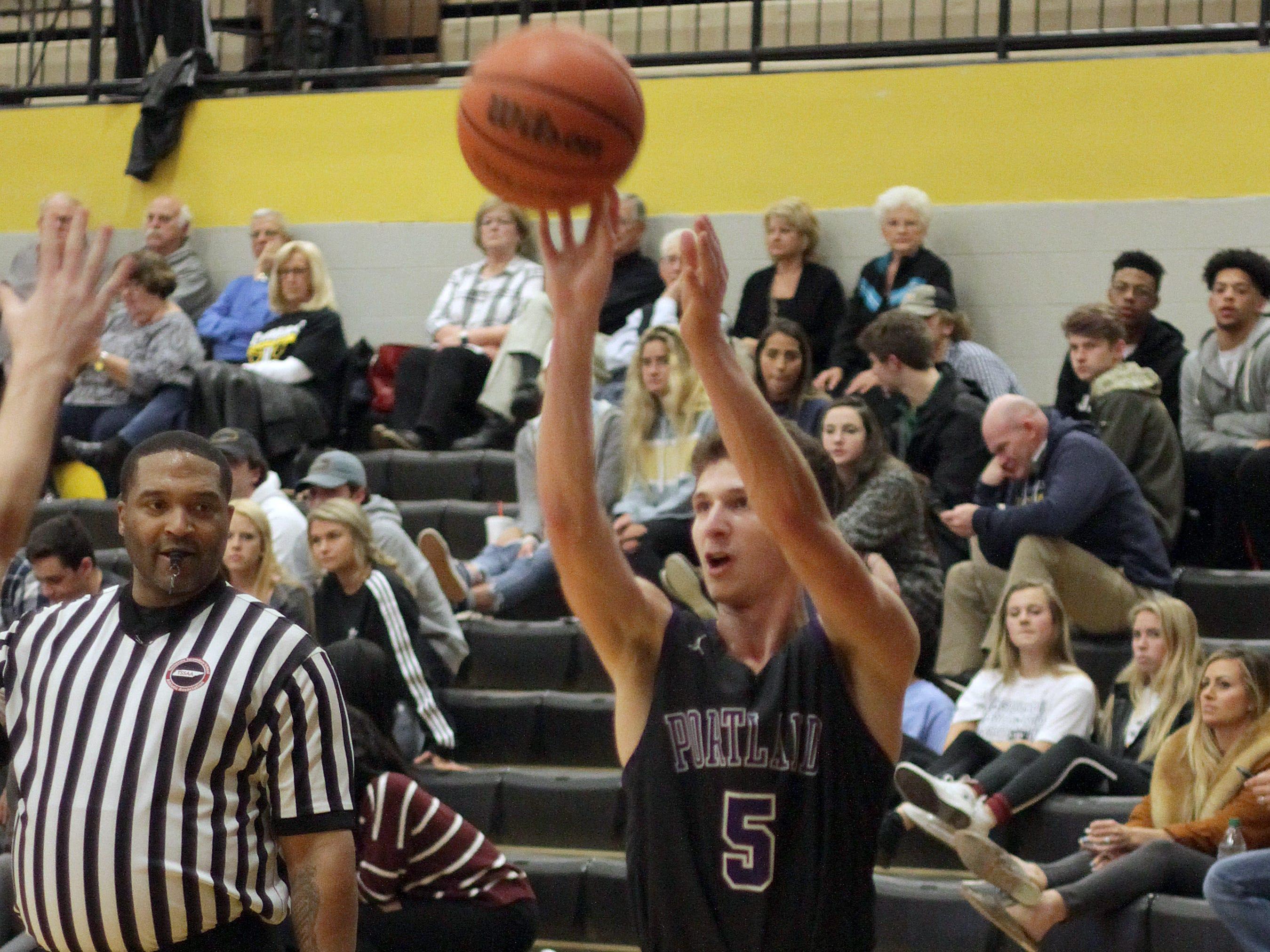Portland's Jakeb Hester shoots for three against Hendersonville on Friday, January 4, 2019. Hendersonville won 62-39.