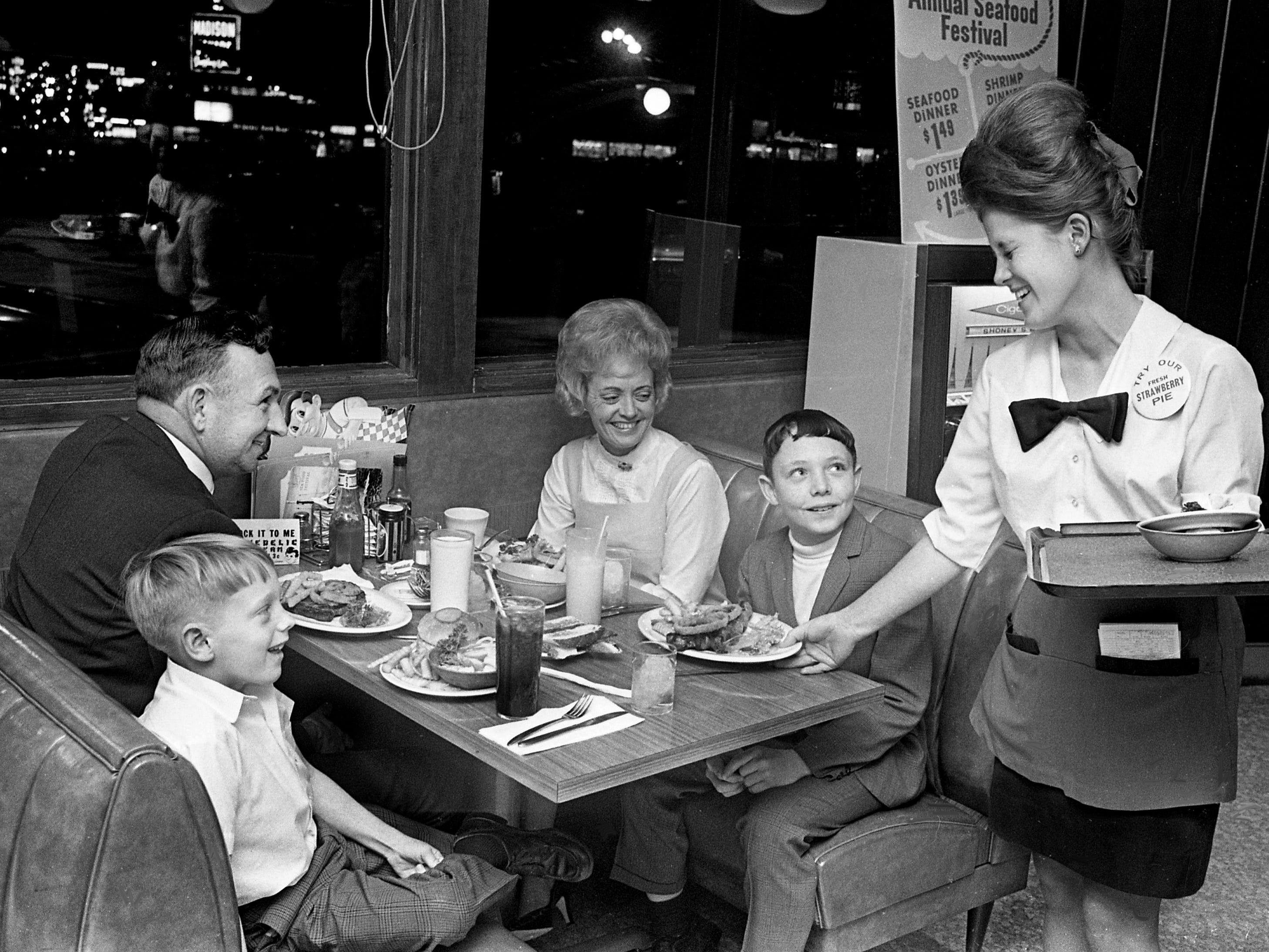 "Waitress Karen Batten, right, serves David Costello, second from right, at Shoney's Restaurant in Madison on Jan. 23, 1969, as his brother Morris Gene and parents, Mr. and Mrs. Glen Costello, look on. David, a student at Isaac Litton Junior High and The Tennessean's ""Newspaper Carrier Boy of the Month,"" was rewarded with a free meal for him and his family for good service to his newspaper customers."