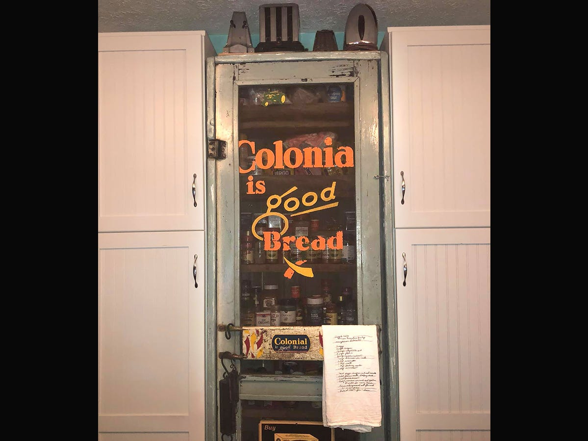 Kathleen Walter repurposed an old market screen door in her retro kitchen to create a spice cabinet.