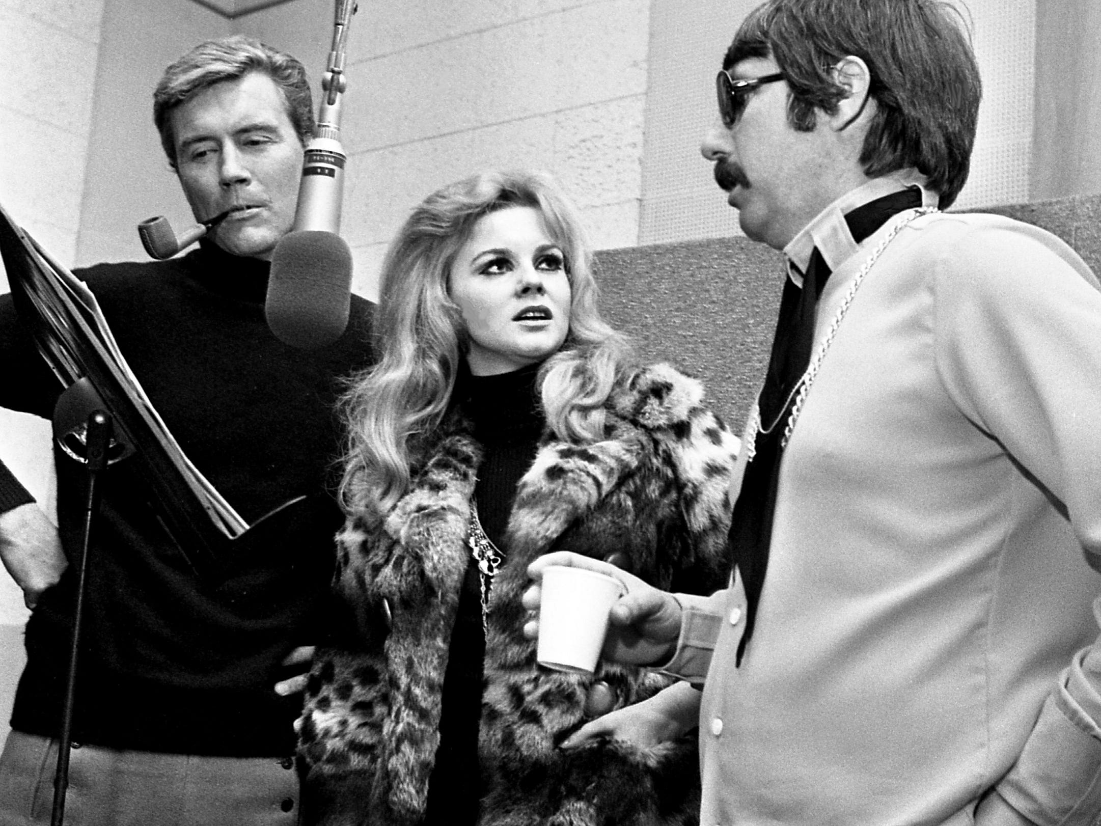 Actress and singing star Ann-Margret, center, tries out a song at RCA Victor studios on 17th Avenue on Jan. 27, 1969, with recording executive Lee Hazelwood, right. Roger Smith, left, the star's husband, assisted as she worked to make her first country music album for and with Hazelwood.