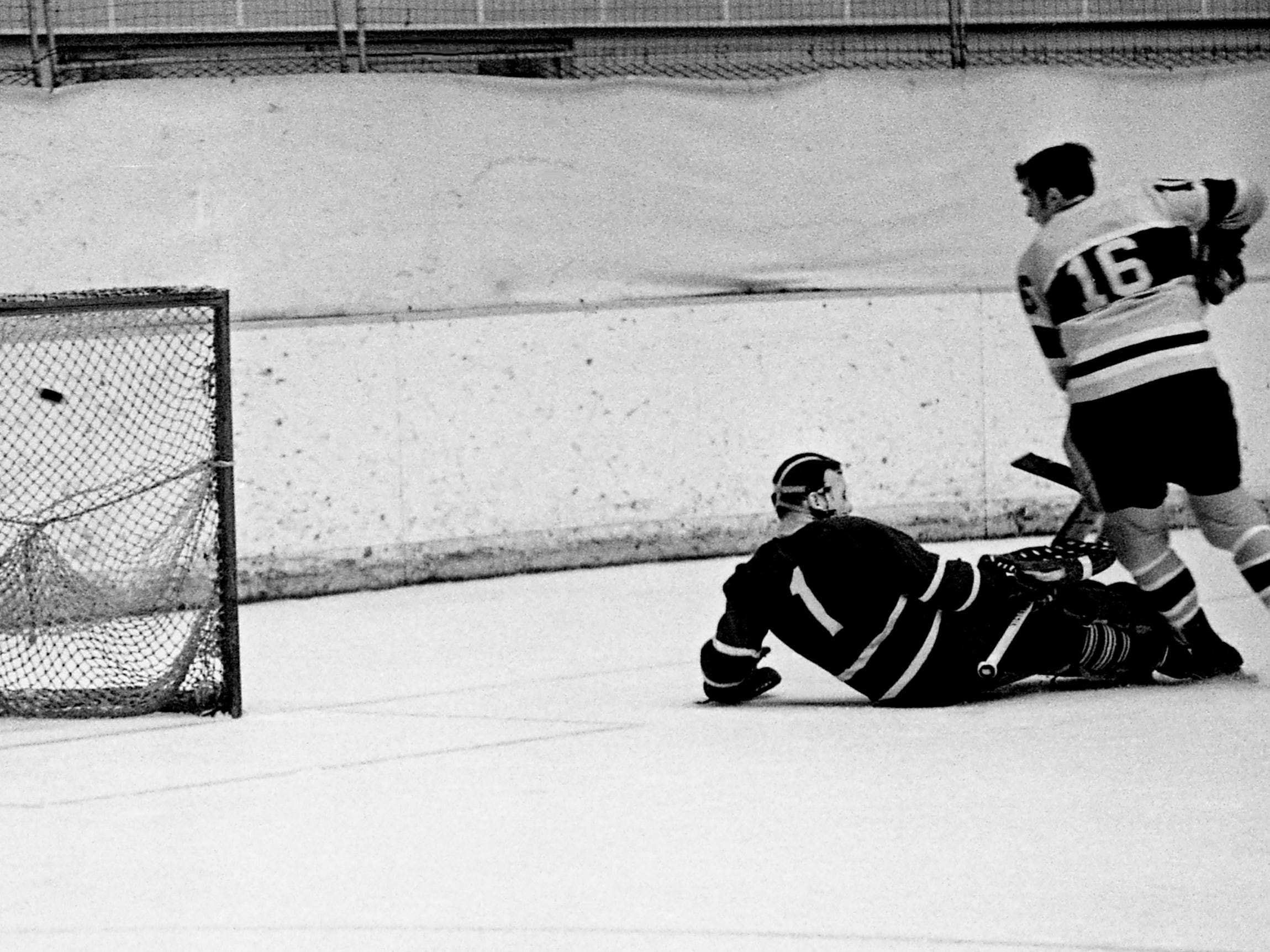 Nashville Dixie Flyers winger Karl Haggarty (16) fires in the team's sixth goal of the evening during a 10-5 victory over the Charlotte Checkers before 2,702 fans at Municipal Auditorium on Jan. 2, 1969. Charlotte goalie Bob Whidden (1) was pulled off balance, leaving an open net for Haggarty.