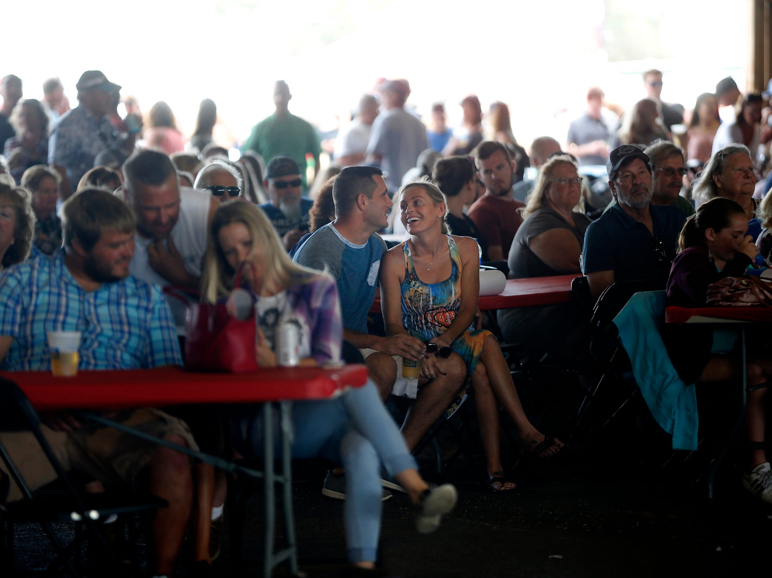 Festivalgoers enjoy music by the Ben Allen Band during the 7th Annual Big Swamp Smoke Off & Craft Beer Festival on Saturday, Jan. 5, 2019, at the Collier County Fairgrounds.