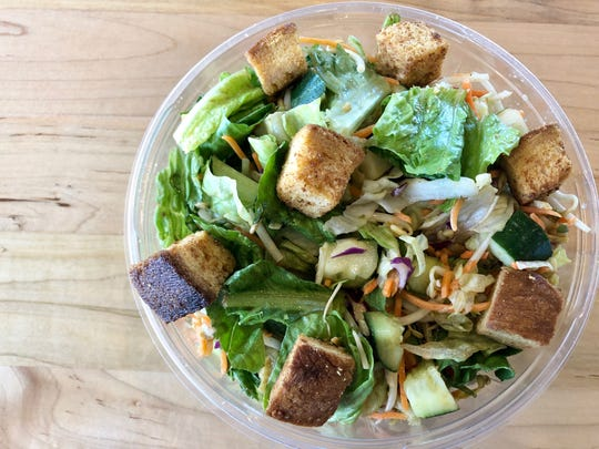 The Thai Thai salad at Giardino Gourmet Salads in North Naples includes brunches of romaine and iceberg, with red cabbage, carrots, cucumbers, bean sprouts and garlic croutons with a spicy peanut dressing.