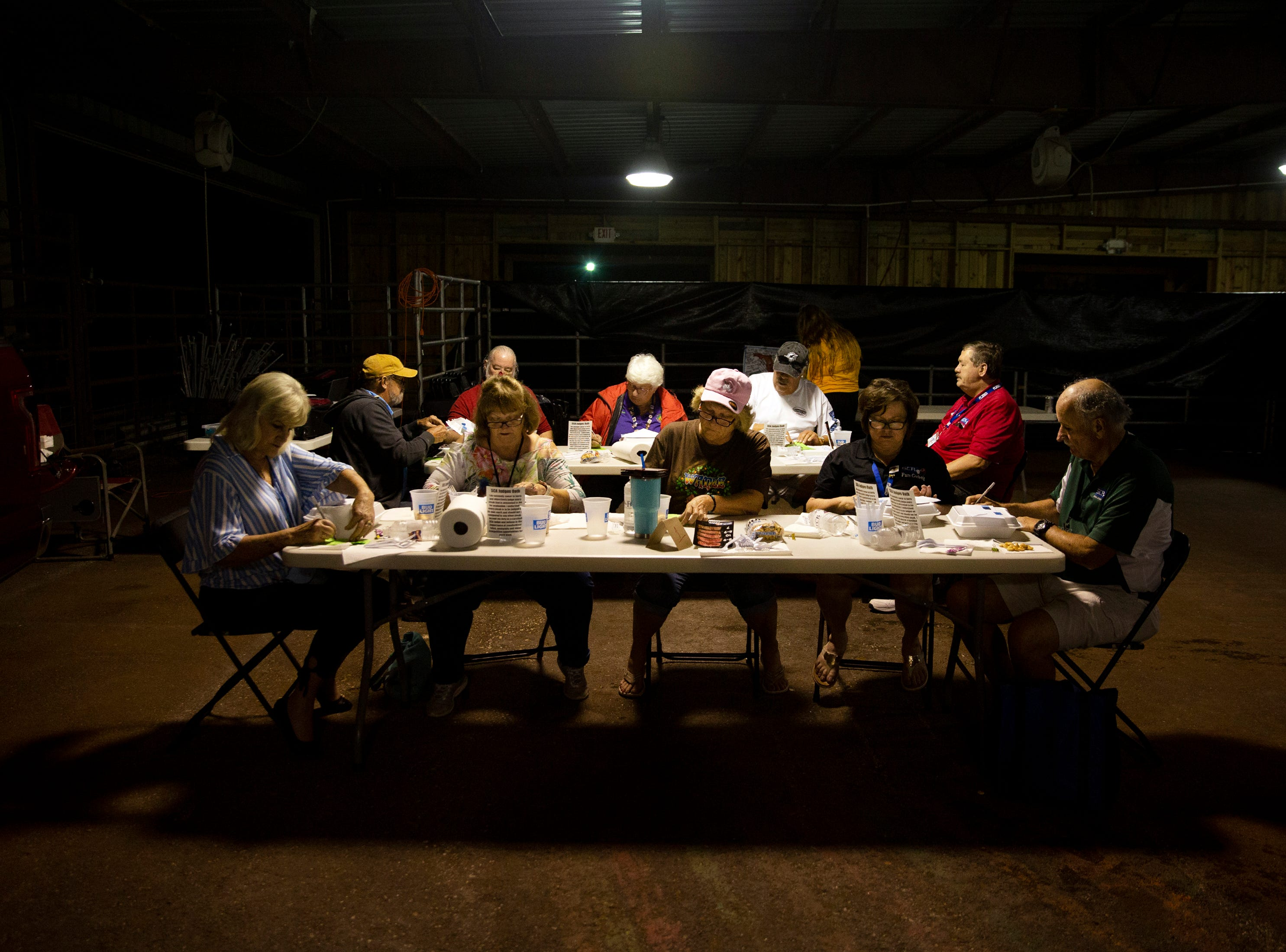A panel of judges go over entries in the first steak competition at the 7th Annual Big Swamp Smoke Off & Craft Beer Festival's on Saturday, Jan. 5, 2019, at the Collier County Fairgrounds.