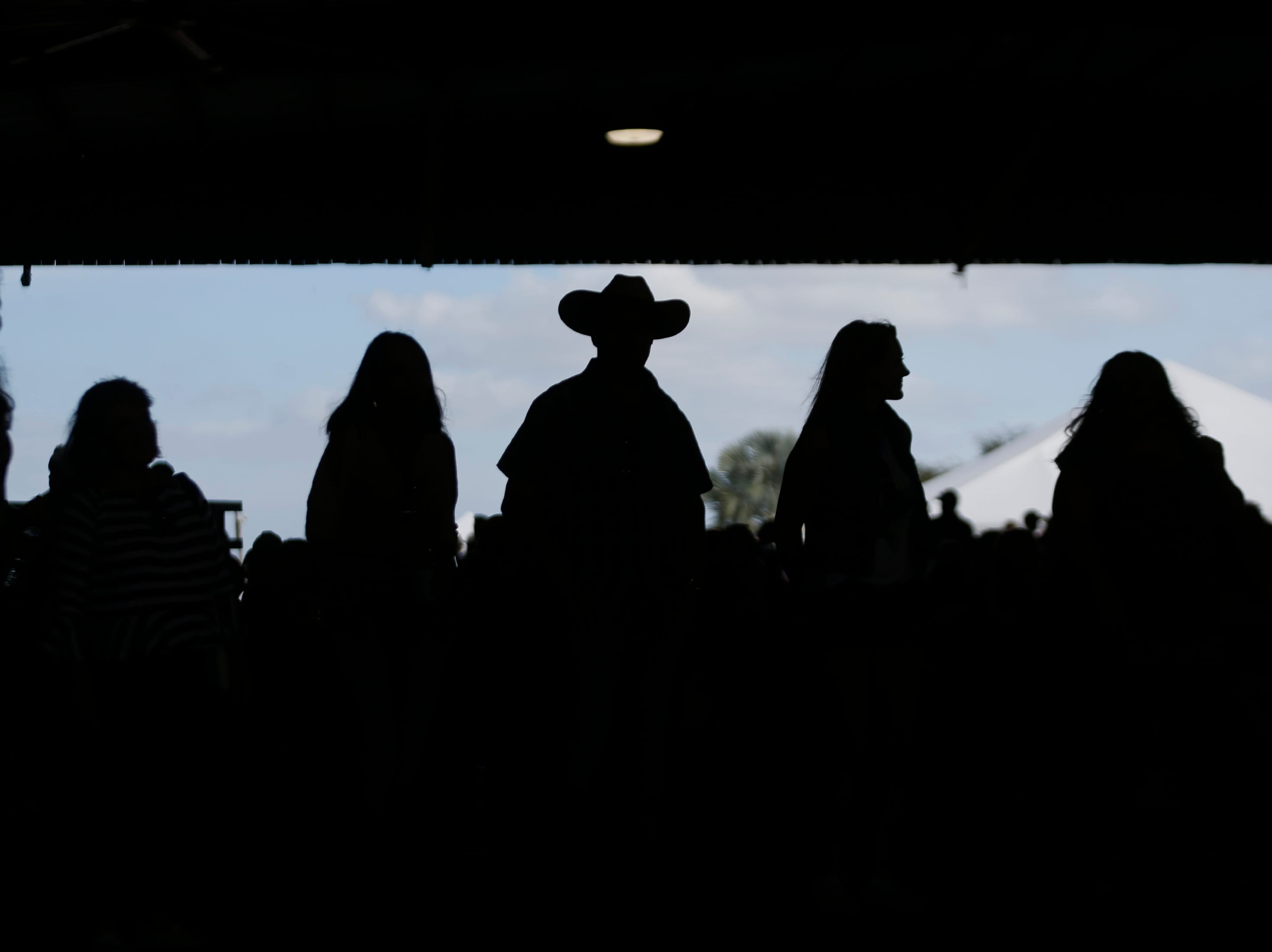 Festivalgoers enjoy food, drinks and live entertainment during the 7th Annual Big Swamp Smoke Off & Craft Beer Festival on Saturday, Jan. 5, 2019, at the Collier County Fairgrounds.