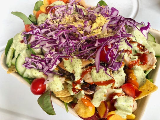 The mung bean taco salad at Organically Twisted is crammed with mung beans, sweet potato and other veggies.