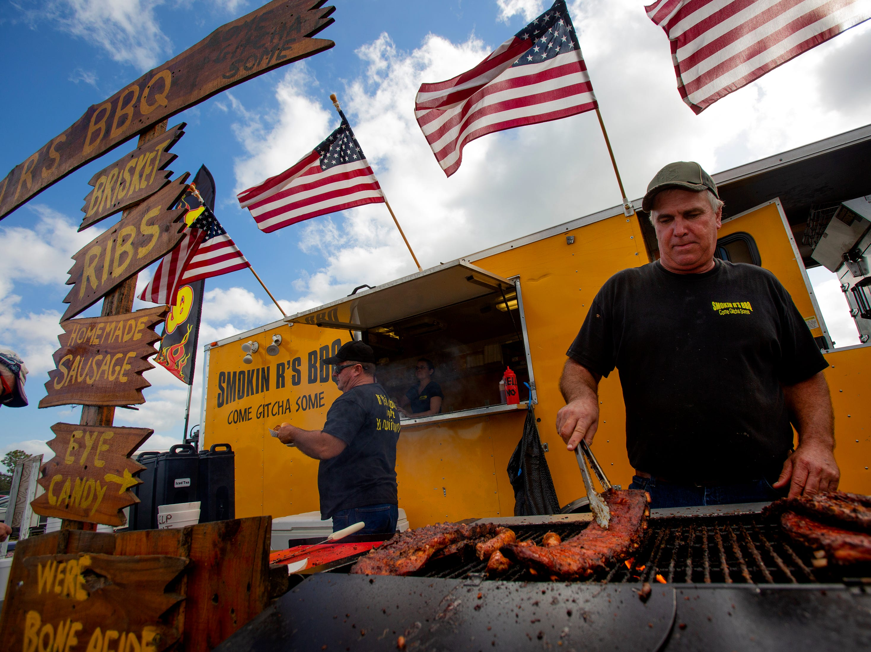 Robert Rivers, owner of Smokin R's BBQ, prepares racks of ribs during the 7th Annual Big Swamp Smoke Off & Craft Beer Festival on Saturday, Jan. 5, 2019, at the Collier County Fairgrounds.