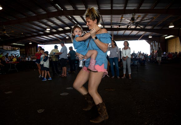 Ashley Graham and her daughter Lauren Graham, 2, dance to the music of the Ben Allen Band during the 7th Annual Big Swamp Smoke Off & Craft Beer Festival on Saturday, Jan. 5, 2019, at the Collier County Fairgrounds.