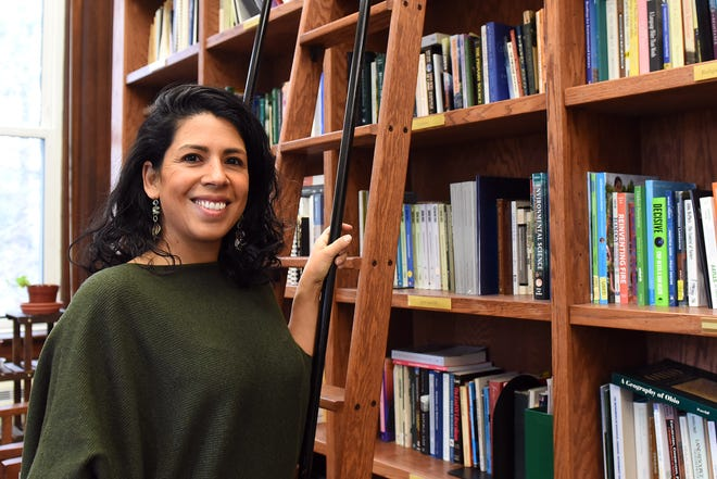 Olivia Aguilar, associate professor of environmental studies at Denison University, in the environmental studies department's Hibbs Library in Barney-Davis Hall. Aguilar grew her love the natural sciences in to an advanced degree in environmental education.
