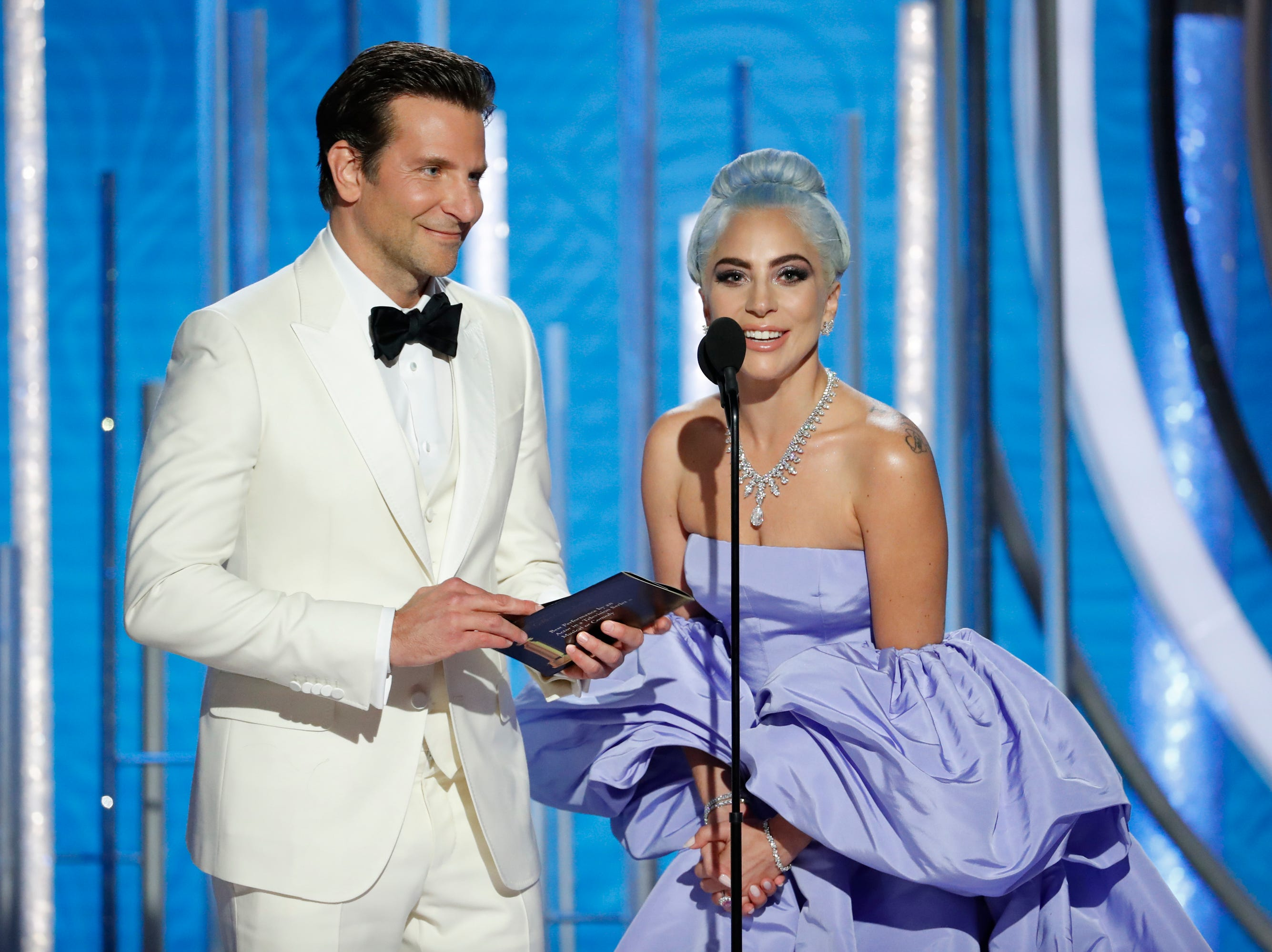 BEVERLY HILLS, CALIFORNIA - JANUARY 06: In this handout photo provided by NBCUniversal, Presenters  Bradley Cooper and Lady Gaga  speak onstage during the 76th Annual Golden Globe Awards at The Beverly Hilton Hotel on January 06, 2019 in Beverly Hills, California.  (Photo by Paul Drinkwater/NBCUniversal via Getty Images)