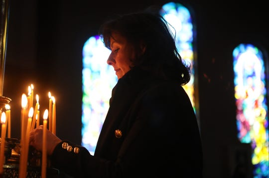 Nila Chejlyk, of Long Hill, lights a candle at the Ukrainian Orthodox Holy Ascension Church, during the Christmas Divine Liturgy service, in Clifton.  The orthodox use the Julian calendar and celebrate Christmas which falls on, January 7th for Gregorian calendar users. Monday, January 7, 2019